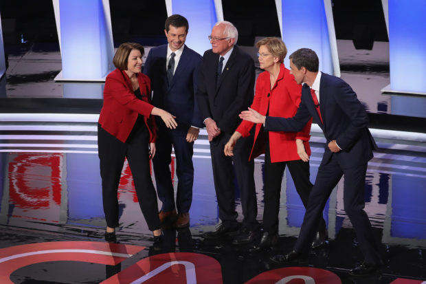 DETROIT, MICHIGAN - JULY 30: Democratic presidential candidates Sen. Amy Klobuchar (D-MN) (L-R) , Indiana Mayor Pete Buttigieg, Sen. Bernie Sanders (I-VT), Sen. Elizabeth Warren (D-MA), and former Texas congressman Beto O'Rourke, take the stage at the beginning of the Democratic Presidential Debate at the Fox Theatre July 30, 2019 in Detroit, Michigan. 20 Democratic presidential candidates were split into two groups of 10 to take part in the debate sponsored by CNN held over two nights at Detroit's Fox Theatre. (Photo by Justin Sullivan/Getty Images)