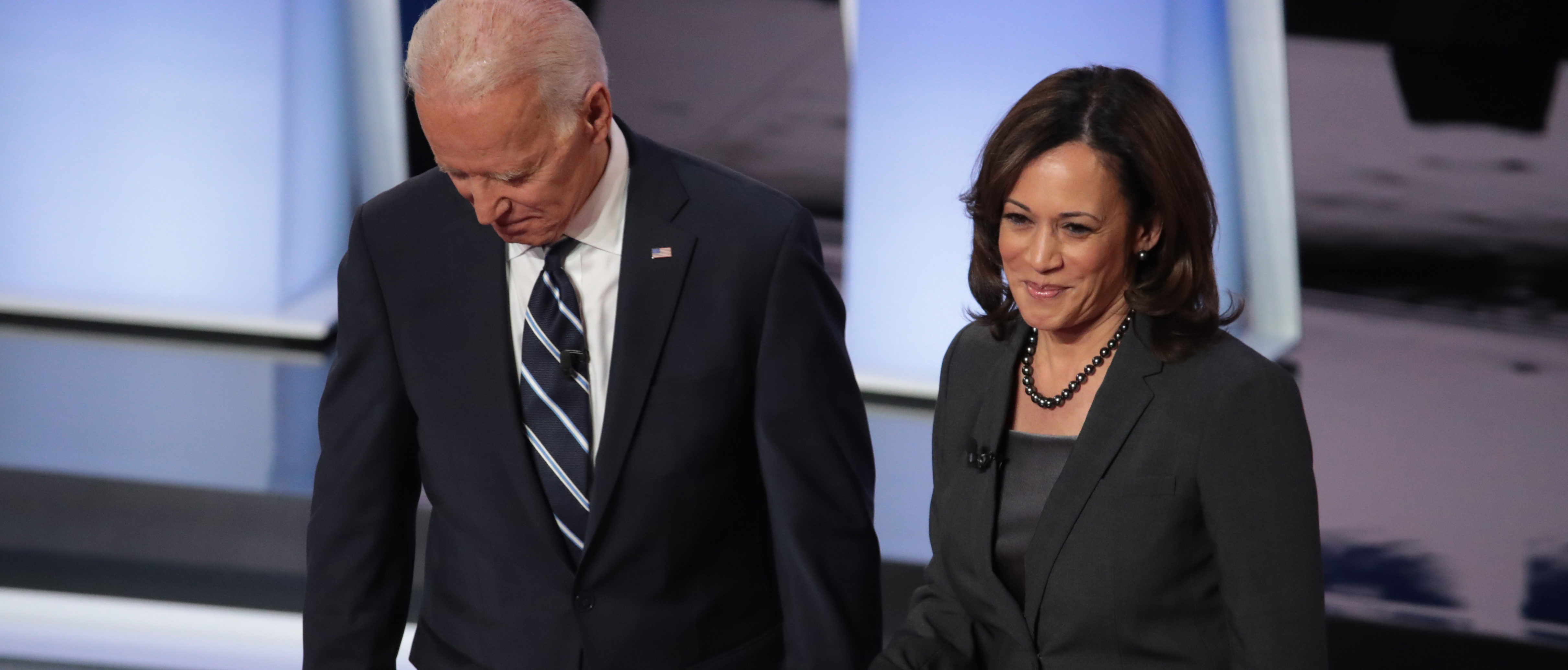 DETROIT, MICHIGAN - JULY 31: Democratic presidential candidates former Vice President Joe Biden and Sen. Kamala Harris (D-CA) greet each other at the Democratic Presidential Debate at the Fox Theatre July 31, 2019 in Detroit, Michigan. 20 Democratic presidential candidates were split into two groups of 10 to take part in the debate sponsored by CNN held over two nights at Detroit's Fox Theatre. (Photo by Scott Olson/Getty Images)