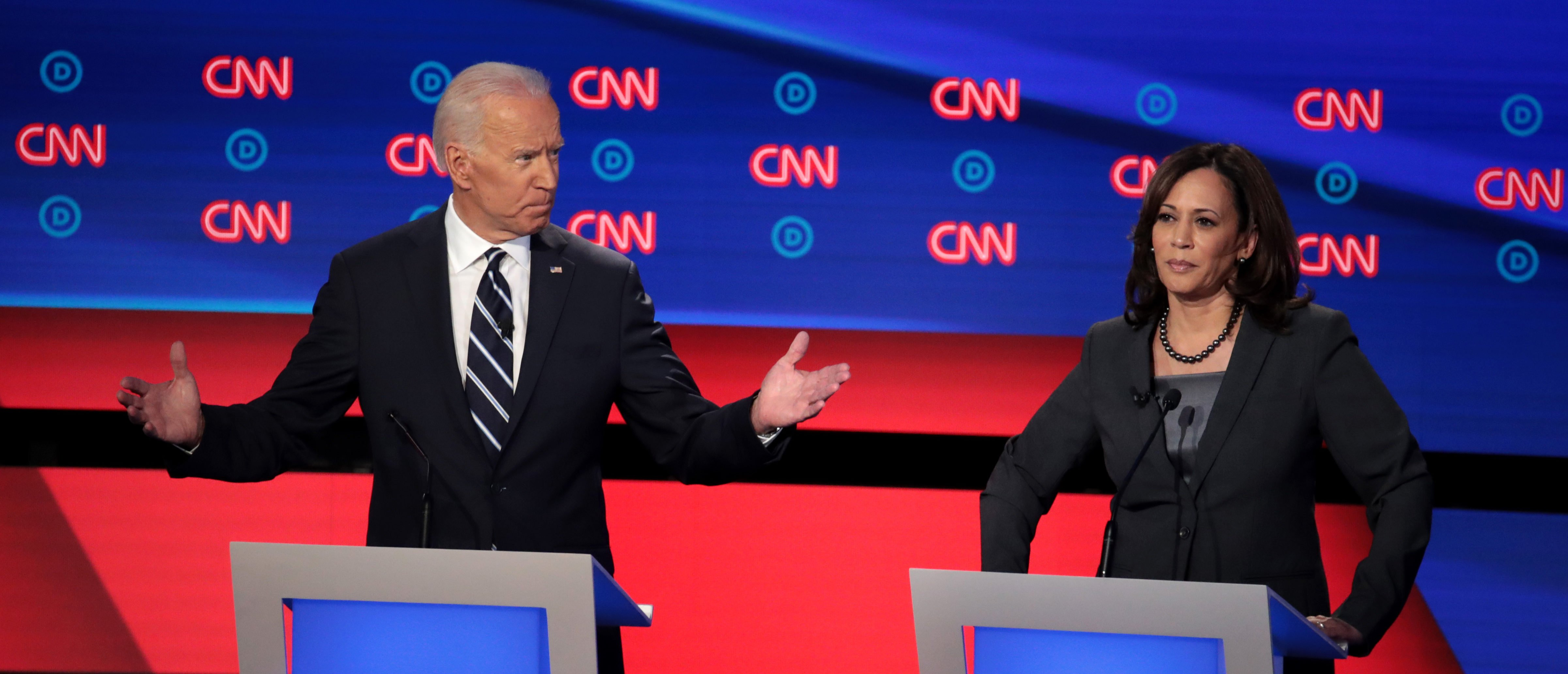 Democratic presidential candidate Joe Biden (L) speaks while Sen. Kamala Harris listens during the Democratic presidential debate at the Fox Theatre July 31, 2019 in Detroit, Michigan. (Scott Olson/Getty Images)
