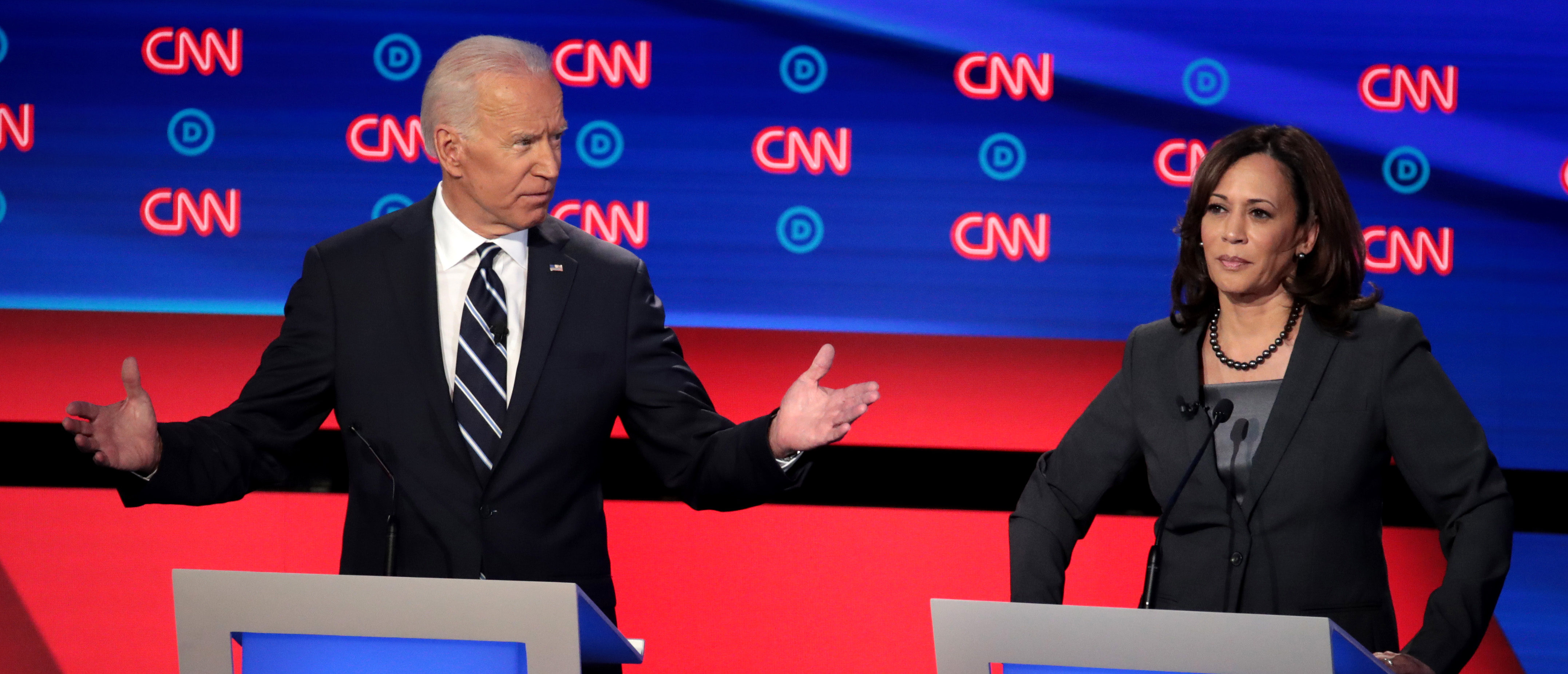 DETROIT, MICHIGAN - JULY 31: Democratic presidential candidate former Vice President Joe Biden (L) and Sen. Kamala Harris (D-CA) during the Democratic Presidential Debate at the Fox Theatre July 31, 2019 in Detroit, Michigan. 20 Democratic presidential candidates were split into two groups of 10 to take part in the debate sponsored by CNN held over two nights at Detroit's Fox Theatre. (Photo by Scott Olson/Getty Images)