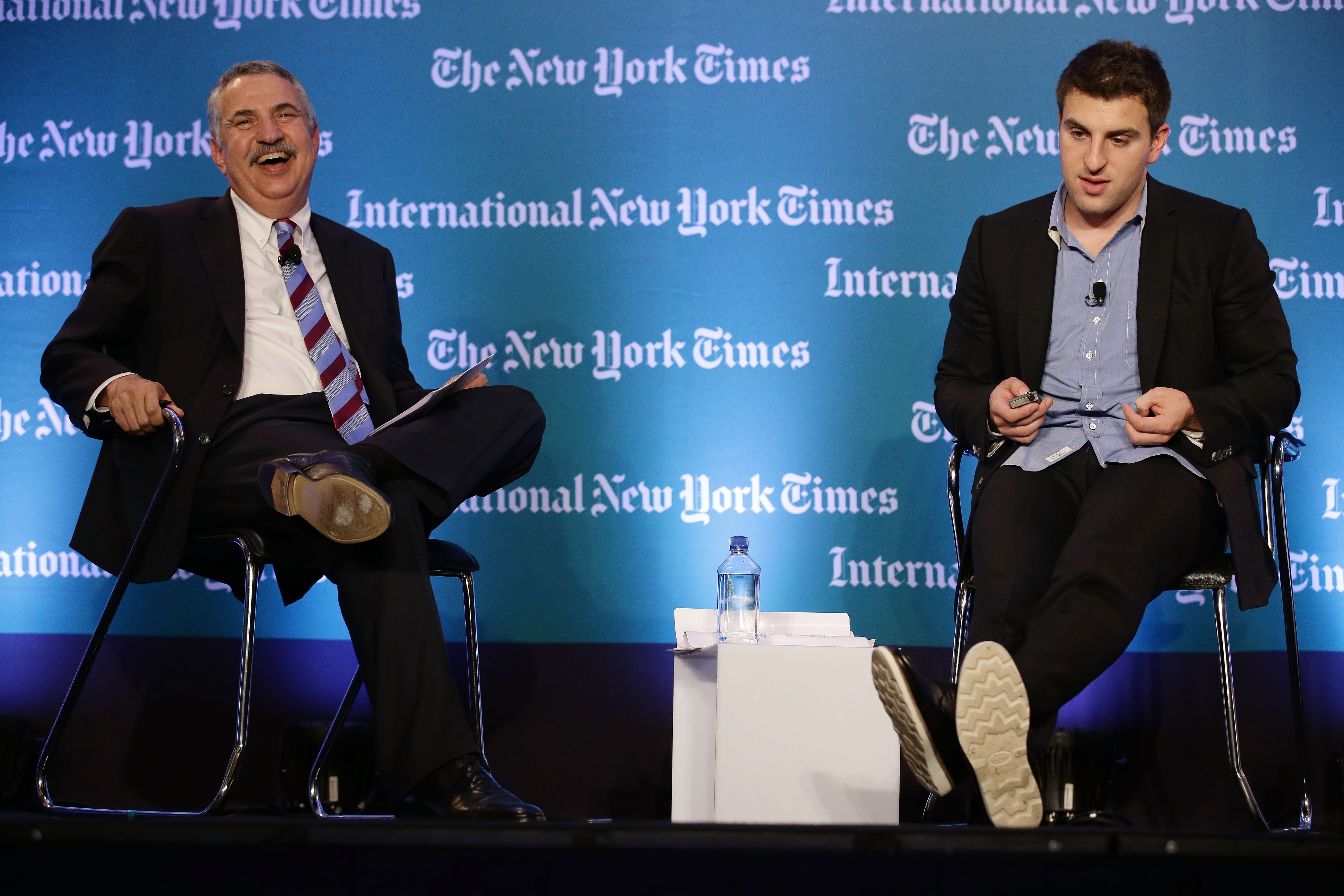 Thomas L. Friedman, Op-Ed columnist, The New York Times(L) speaks with Brian Chesky, CEO and Co-Founder, AirBNB during the International New York Times Global Forum Singapore - Thomas L. Friedman's The Next New World Global Forum Asia at the Four Seasons Hotel on October 25, 2013 in Singapore. (Photo by Suhaimi Abdullah/Getty Images for International New York Times)