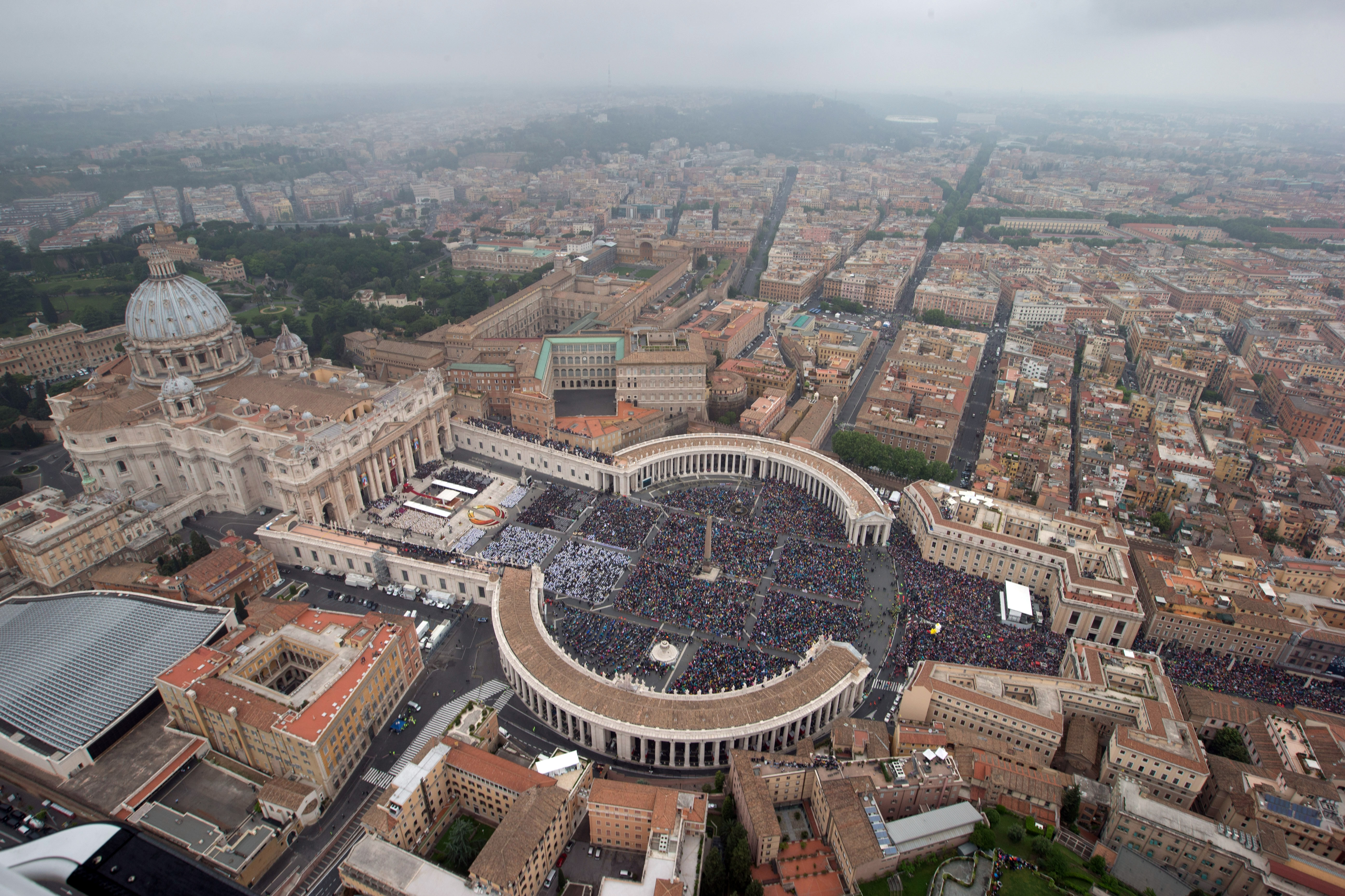 In this handout photo provided by the Italian National Police, an aerial view of St. Peter's Square and Via della Conciliazione is seen as Pope Francis leads a Canonization Mass in which John Paul II and John XXIII are to be declared saints on April 27, 2014 in Vatican City, Vatican. Dignitaries, heads of state and Royals from around the world attended the canonisations in the Vatican today. (Photo by Massimo Sestini/Italian National Police via Getty Images)