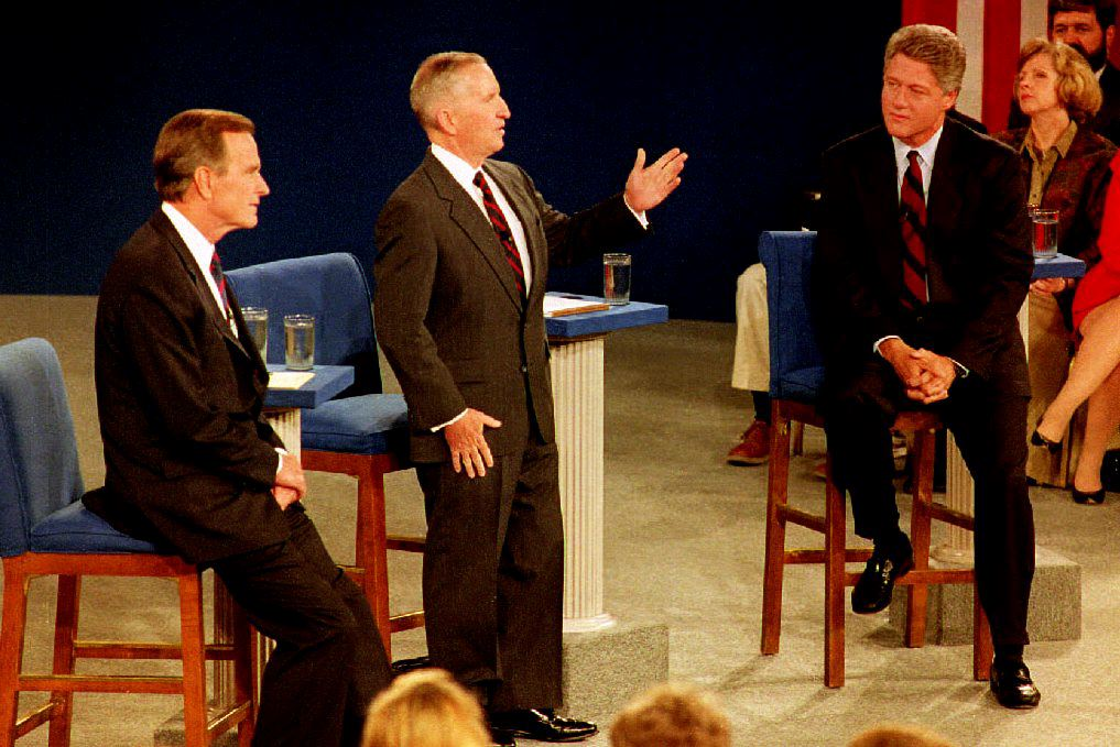 U.S. presidential candidate Bill Clinton(R), and U.S. President George Bush (L) listen as Independent presidential candidate Ross Perot (C) answers a question 15 October, 1992 at the University of Richmond in Richmond, Virginia. The three met in their second of three presidential debates. ( J. DAVID AKE/AFP/Getty Images)