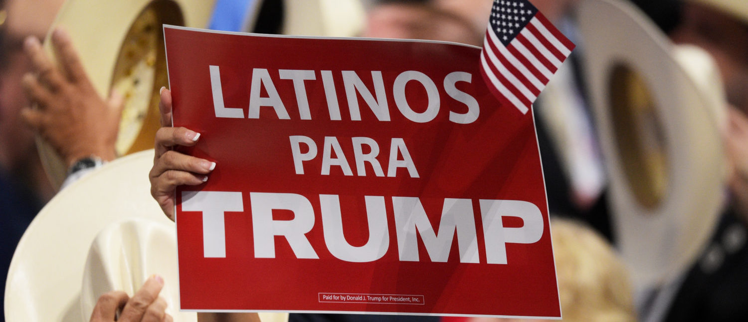 """CLEVELAND, OH - JULY 21: A delegate holds up sign that reads """"Latinos Para Trump"""" during the evening session on the fourth day of the Republican National Convention on July 21, 2016 at the Quicken Loans Arena in Cleveland, Ohio. Republican presidential candidate Donald Trump received the number of votes needed to secure the party's nomination. An estimated 50,000 people are expected in Cleveland, including hundreds of protesters and members of the media. The four-day Republican National Convention kicked off on July 18. (Photo by Jeff Swensen/Getty Images)"""