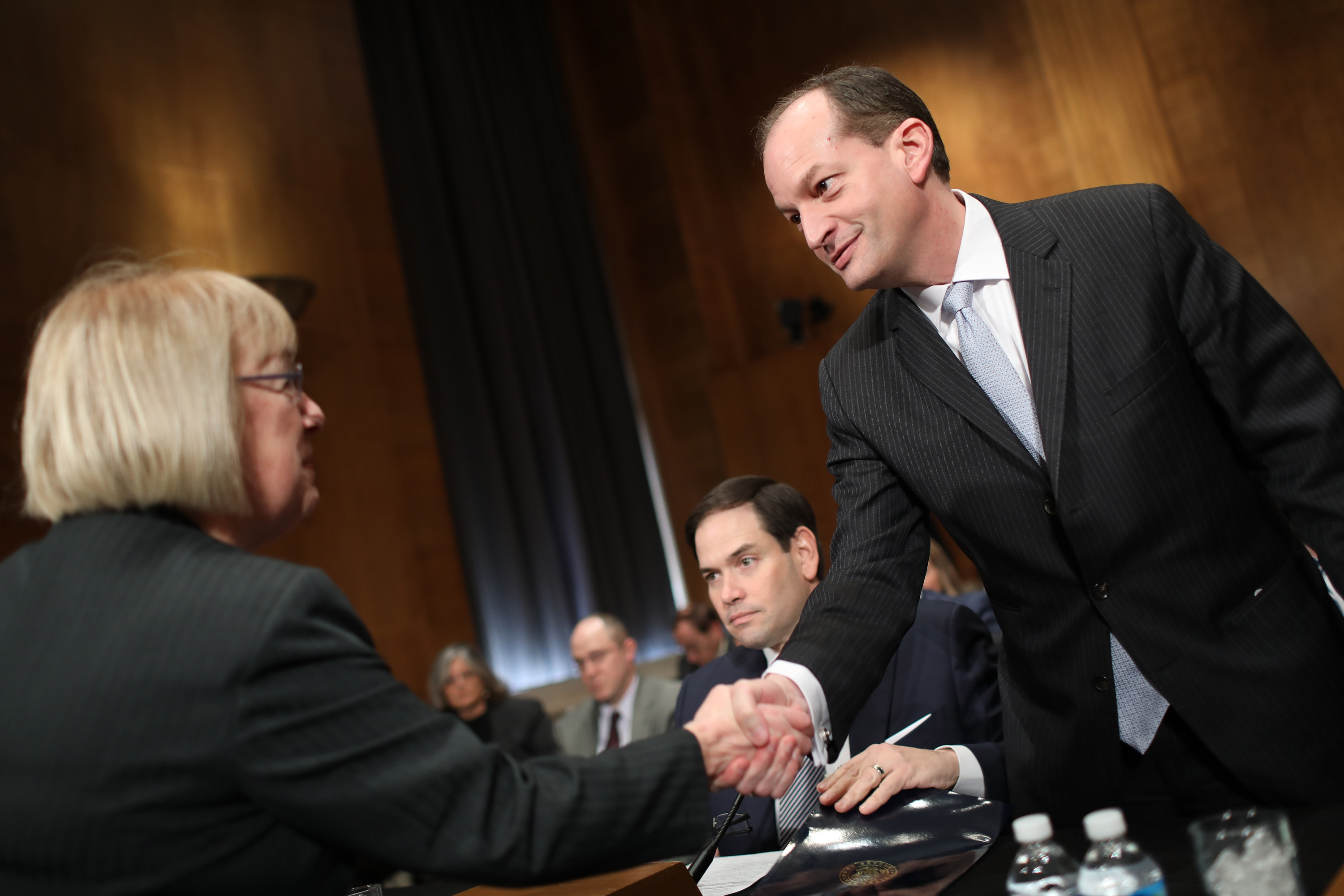 WASHINGTON, DC - MARCH 22: Ranking member U.S. Sen. Patty Murray (L) (D-WA) greets Labor Secretary nominee Alexander Acosta (R) before Acosta's testimony before the Senate Health, Education, Labor and Pensions Committee during his confirmation hearing March 22, 2017 in Washington, DC. Acosta was questioned by members of the committee on his opinions relating to overtime rules during the early portion of the hearing. Also pictured is Sen. Marco Rubio (L) who introduced Acosta. (Photo by Win McNamee/Getty Images)