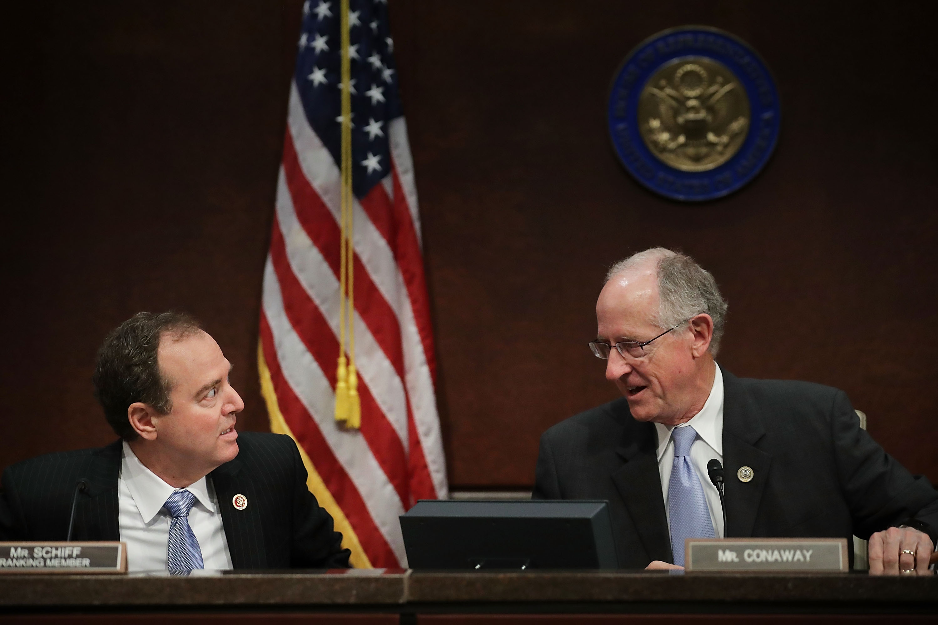 House Intelligence Committee ranking member Rep. Adam Schiff (D-CA) and Rep. Mike Conaway, who is heading the committee's investigatoin into the Russian intereference in the 2016 presidential elections, talk to each other during an open hearing in the U.S. Capitol Visitors Center June 21, 2017 in Washington, DC. (Photo by Chip Somodevilla/Getty Images)