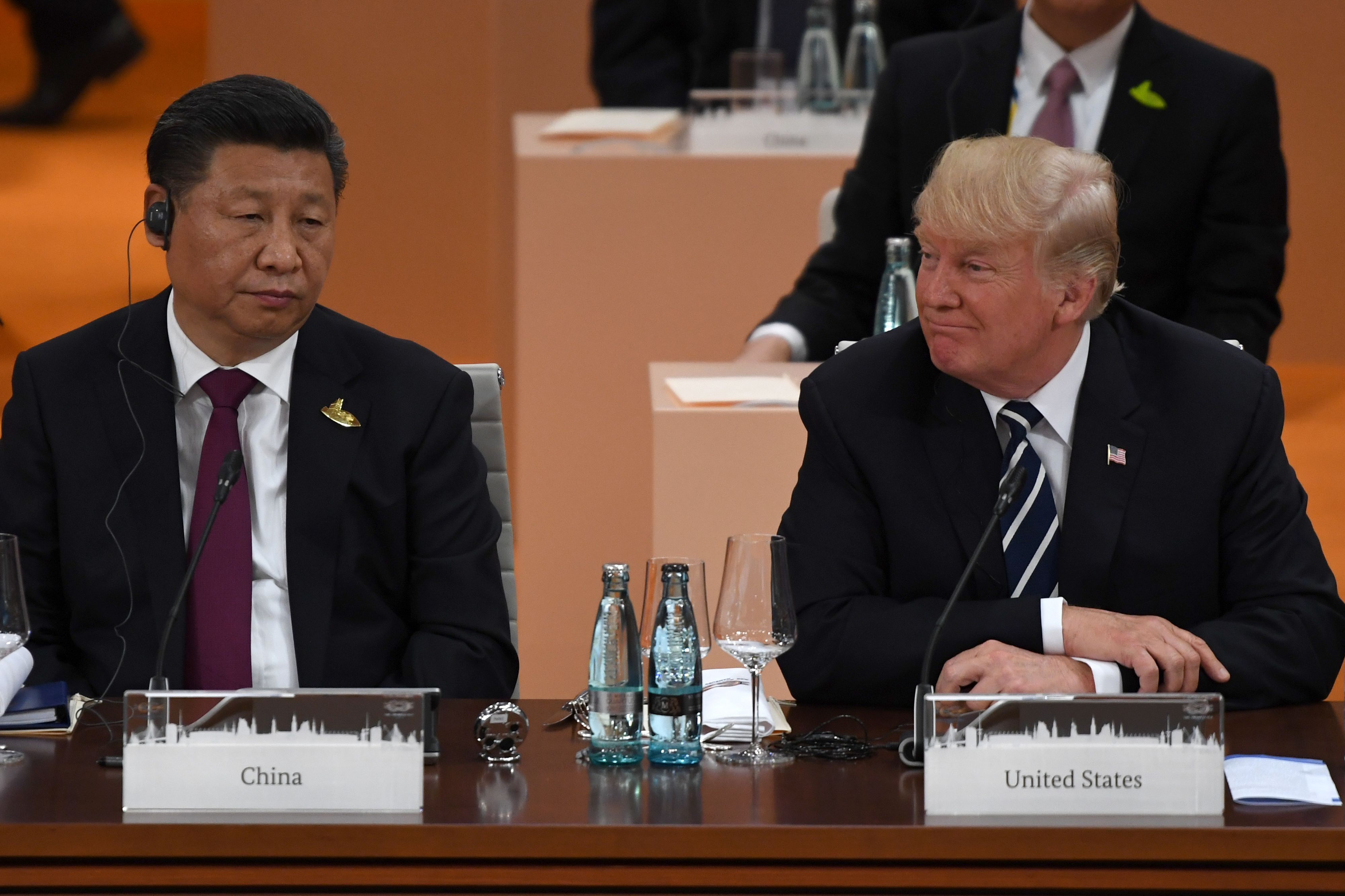 China's President Xi Jinping (L) and US President Donald Trump attend a working session on the first day of the G20 summit in Hamburg, northern Germany, on July 7, 2017. Leaders of the world's top economies gather from July 7 to 8, 2017 in Germany for likely the stormiest G20 summit in years, with disagreements ranging from wars to climate change and global trade. (PATRIK STOLLARZ/AFP/Getty Images)