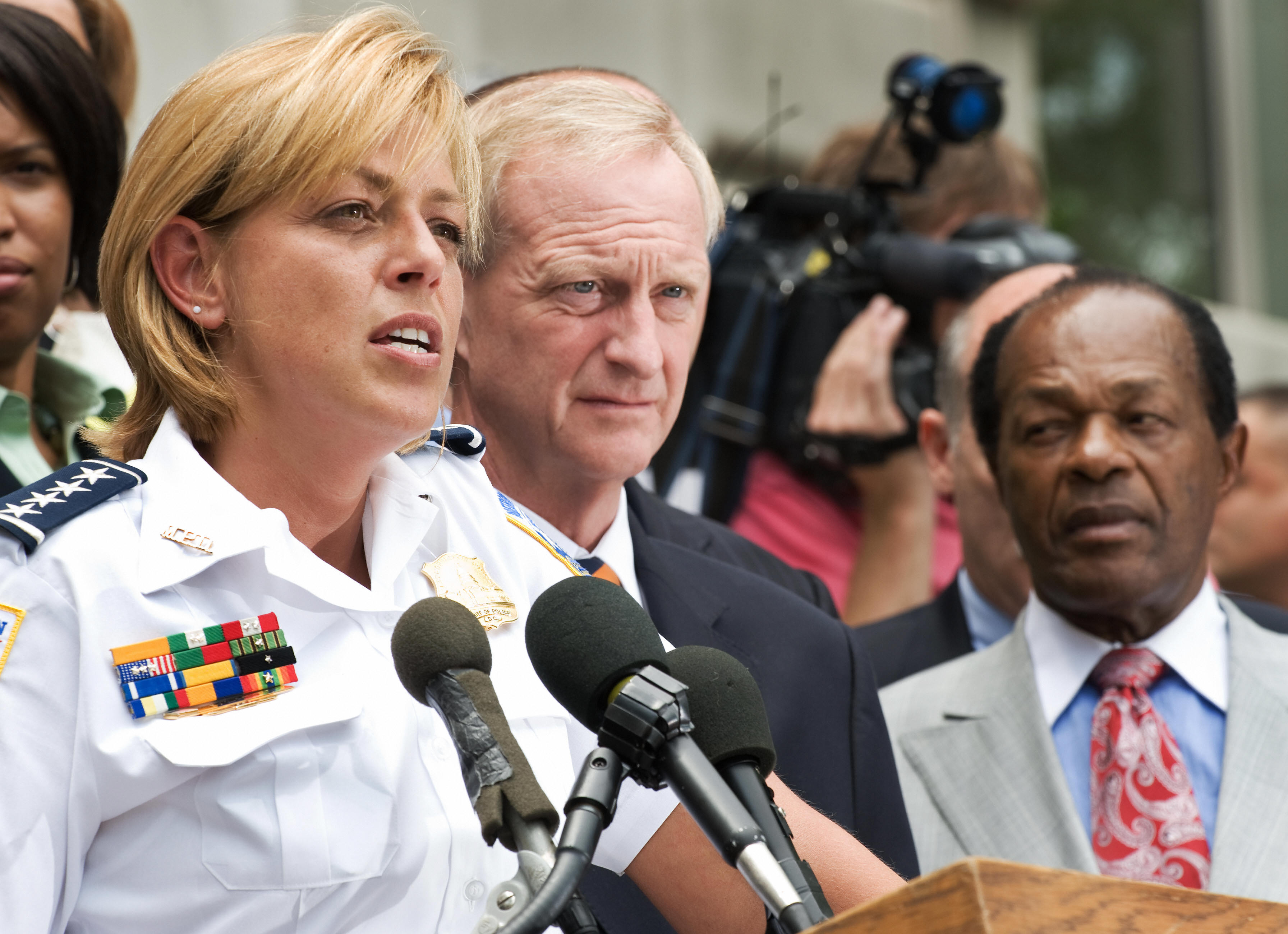 Washington, DC, Police Chief Cathy L. Lanier(L), City Council members Jack Evans(C), and Marion Barry(R) listen to reporter's questions as they conduct a press conference on the steps of the John A. Wilson Building June 26, 2008 reacting after the the Supreme Court decision, District of Columbia v. Heller, which was argued nearly four months ago, to settle the decades-old debate over whether the Second Amendment grants individuals the right to own firearms. (Photo: PAUL J. RICHARDS/AFP/Getty Images)