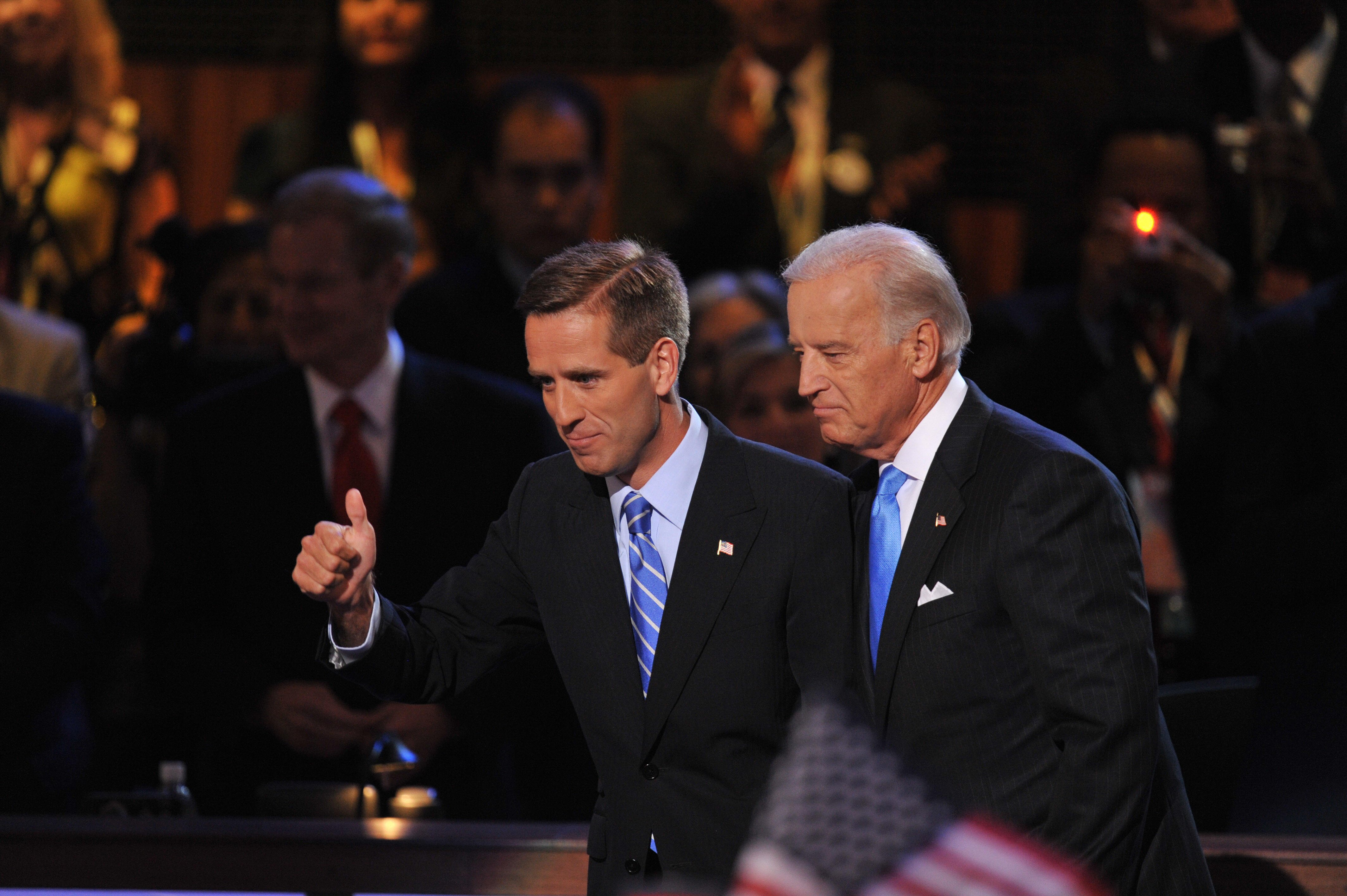 Democratic vice presidential nominee Joe Biden and his son Beau acknowledge the crowd during the Democratic National Convention August 27, 2008 at the Pepsi Center in Denver, Colorado. (PAUL J. RICHARDS/AFP/Getty Images)