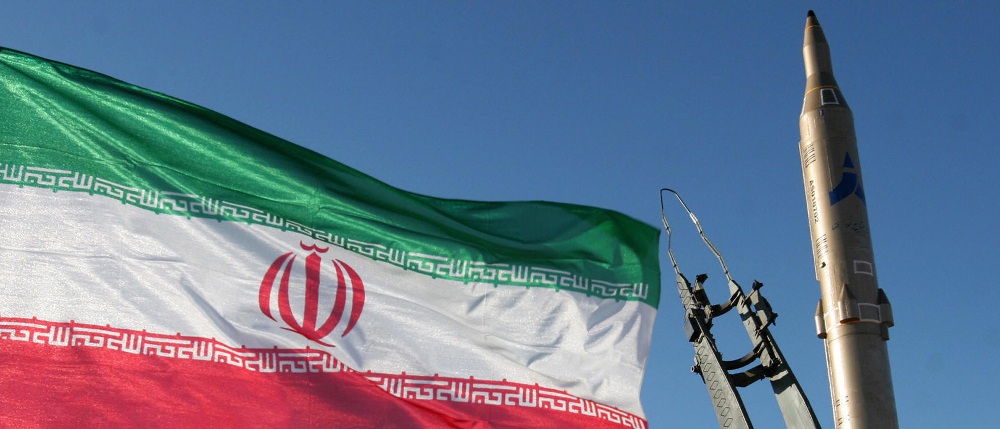 An Iranian flag flutters next to a ground-to-ground Sajil missile before being launched at an undisclosed location in Iran on November 12, 2008. Iran test fired today a new generation of ground-to-ground missile, the semi-official Fars news agency quoted the defence minister as saying. In the past Iran has often boasted of developing new weapons systems only to be met with scepticism from Western defence analysts. (Photo credit should read -/AFP/Getty Images)