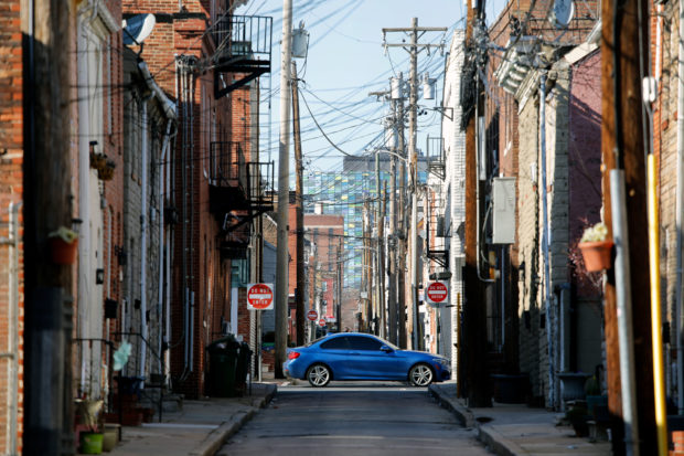 A car drives down a street in Baltimore, MD on March 26, 2018. (Photo by David GANNON /Getty Images)