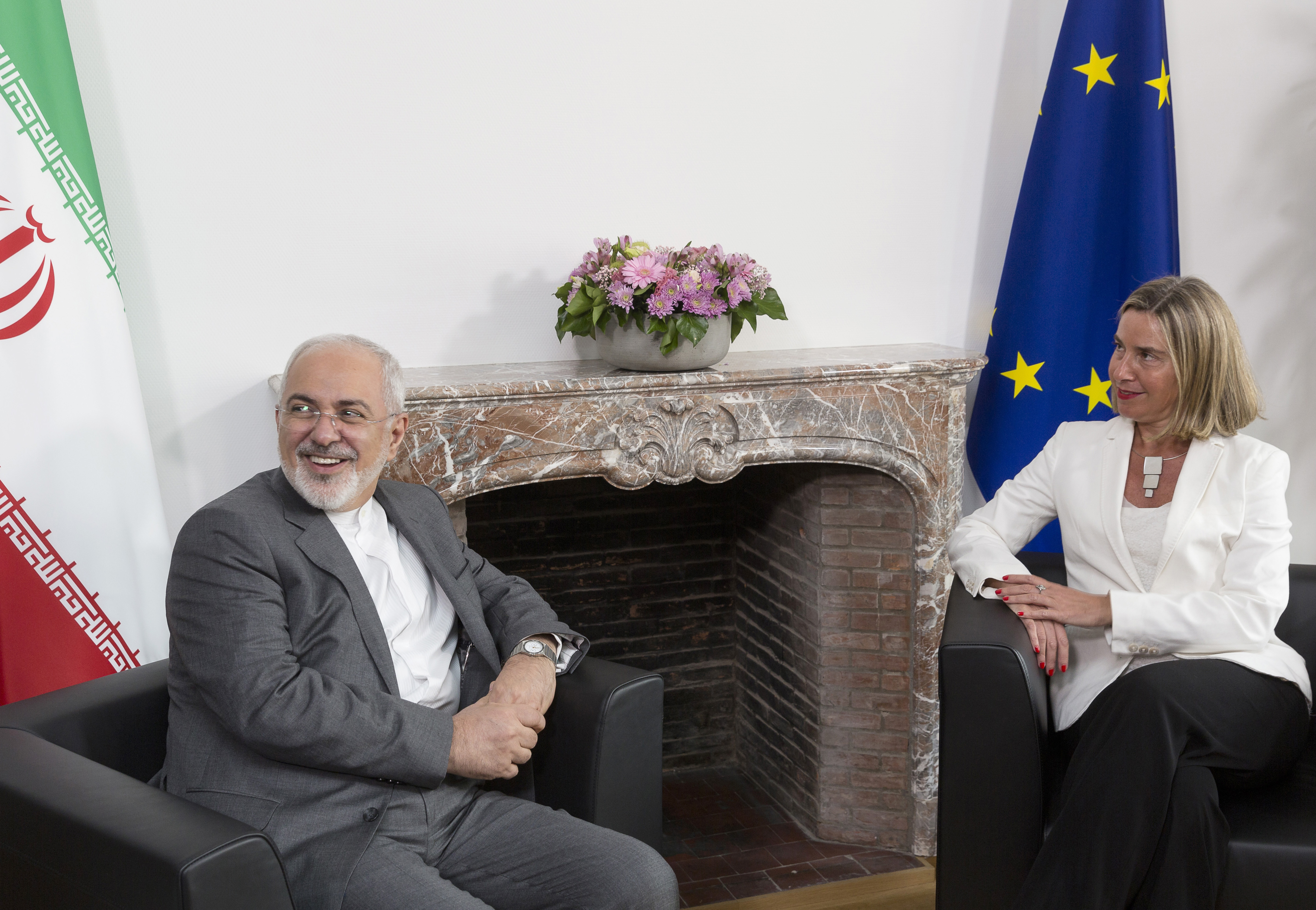 Iranian Foreign Minister Mohammad Javad Zarif (L) meets with European Union Foreign Policy Chief Federica Mogherini, to discuss Iran's nuclear deal, on May 15, 2018 at the EU headquarters in Brussels. - Iran's foreign minister landed in Brussels on May 14 on the final leg of a global tour rallying diplomatic support for the country's nuclear deal after the US President Donald Trump administration's abrupt withdrawal. Mohammad Javad Zarif will meet with his counterparts from Britain, France and Germany -- the three European nations involved in the landmark deal who are incensed by Washington's abandonment of the pact. (Photo by Thierry Monasse / POOL / AFP) (Photo credit should read THIERRY MONASSE/AFP/Getty Images)