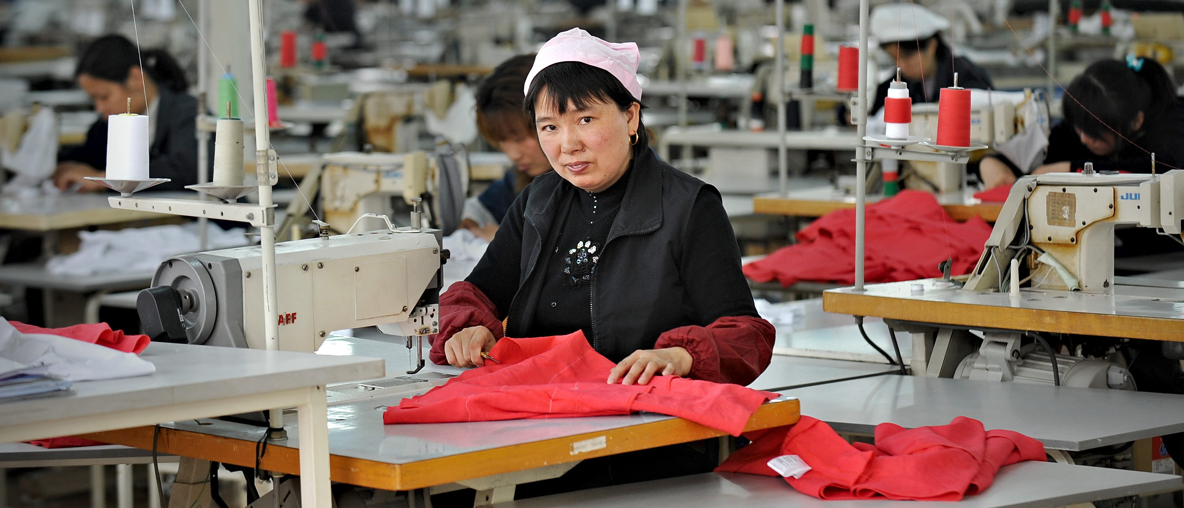 A Chinese worker looks on from her work station at a garment factory in Pinghu some 100 kms from Shanghai on April 10, 2010. China posted its first monthly trade deficit in six years in March 2010 as imports rocketed, far outstripping the growth in exports, customs officials announced on April 10, 2010. AFP PHOTO/PHILIPPE LOPEZ (Photo: PHILIPPE LOPEZ/AFP/Getty Images)