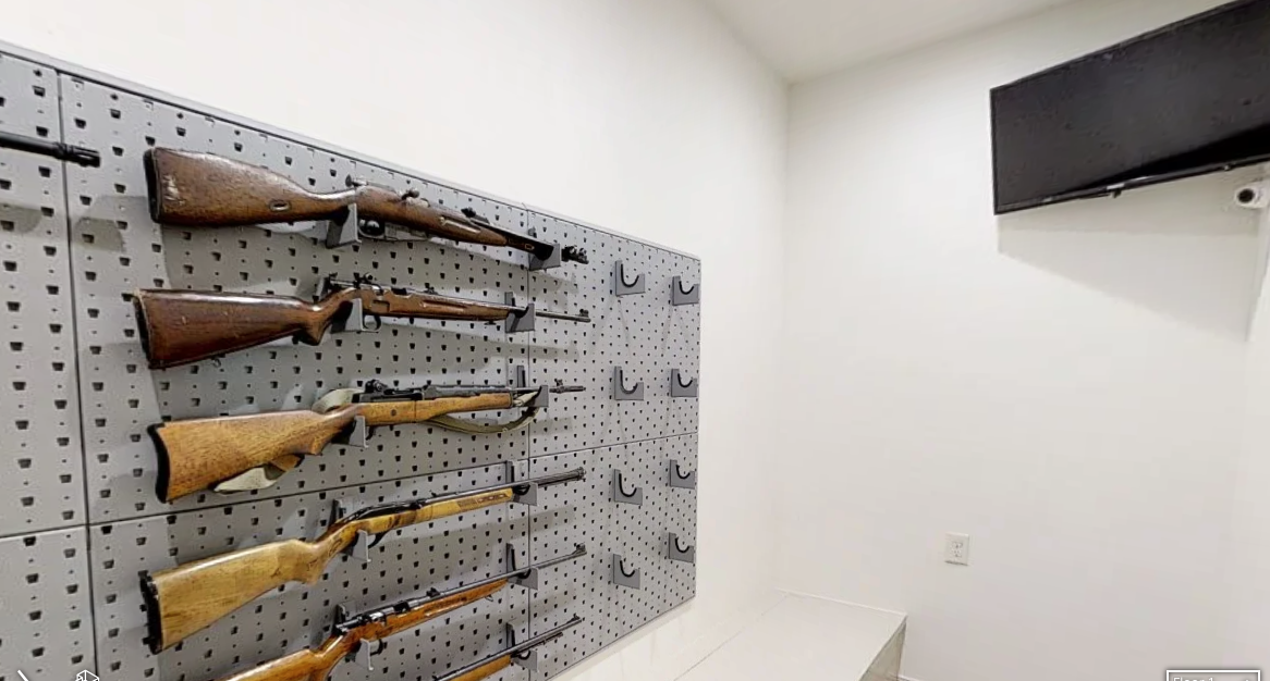 The gun room inside a home being sold by Michelle and Jim Bob Duggar. The 10,000-square foot property in Springdale, Arkansas includes three kitchens and a 3,500 square foot garage. Photo courtesy of Realtor.com