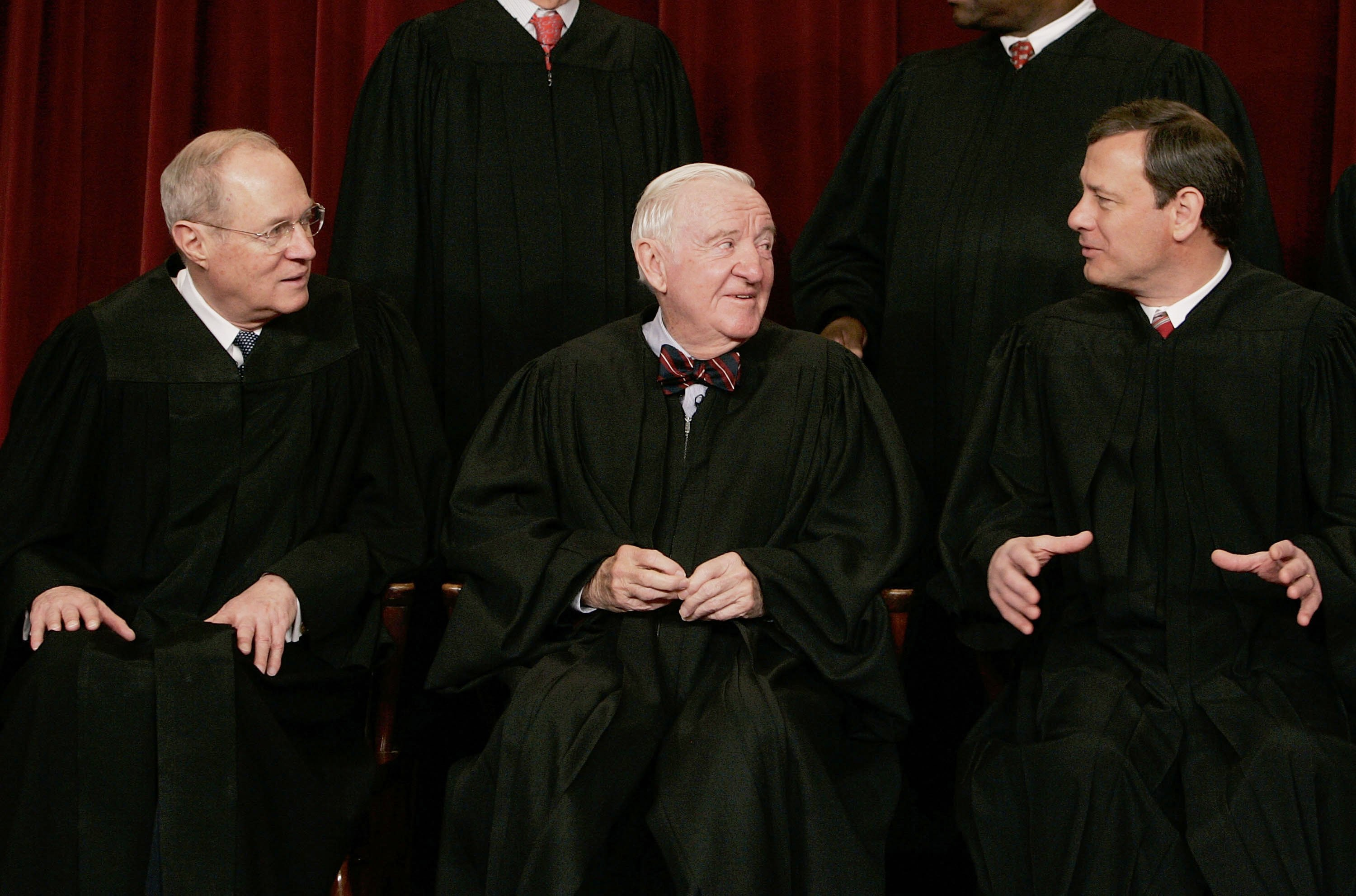 (L to R) Justices Anthony Kennedy, John Paul Stevens, and Chief Justice John Roberts chat during a photo session on March 3, 2006. (Mark Wilson/Getty Images)
