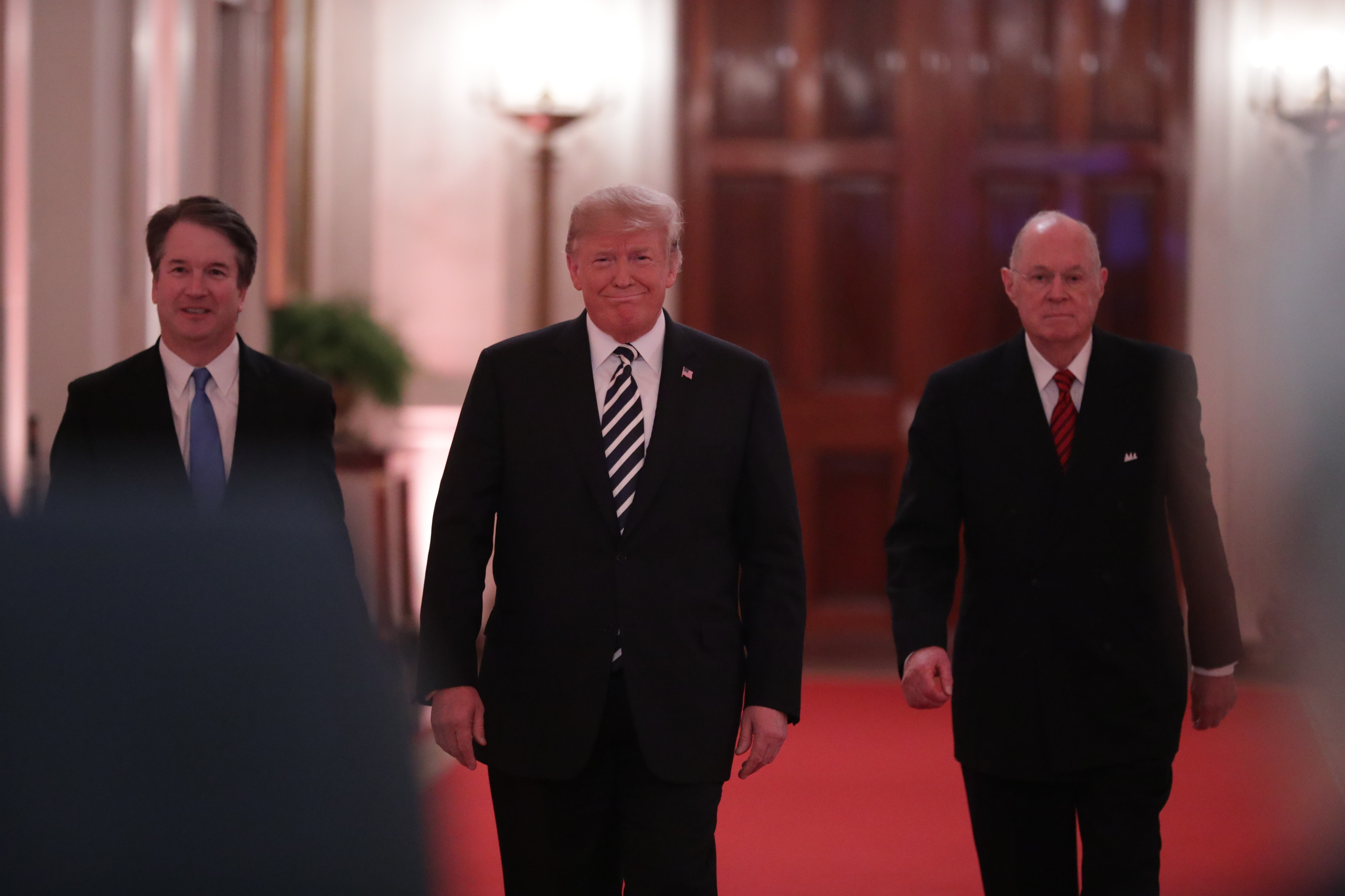 (L-R) Justice Brett Kavanaugh, President Donald Trump and retired Justice Anthony Kennedy arrive in the East Room of the White House on October 08, 2018. (Chip Somodevilla/Getty Images)