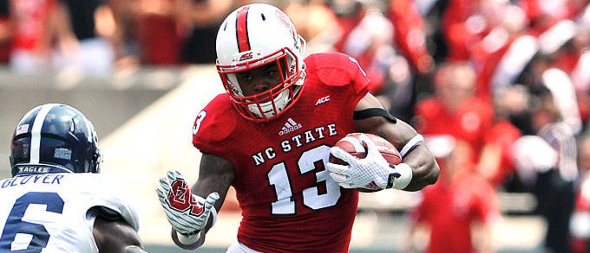 RALEIGH, NC - AUGUST 30: Bra'Lon Cherry #13 of the North Carolina State Wolfpack runs with the ball against Antonio Glover #16 of the Georgia Southern Eagles at Carter-Finley Stadium on August 30, 2014 in Raleigh, North Carolina. (Photo by Lance King/Getty Images)