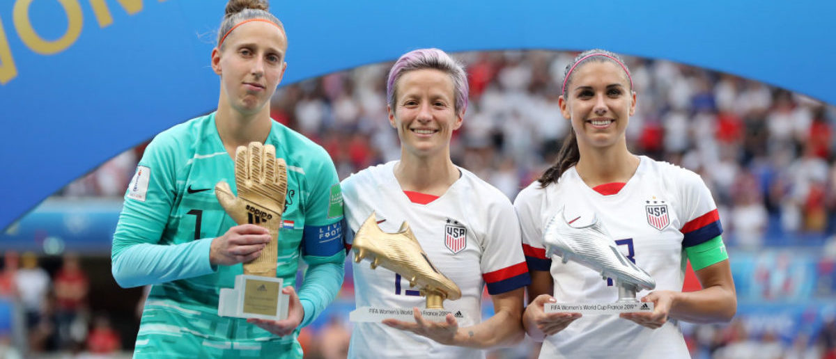 LYON, FRANCE - JULY 07: (L-R) Sari Van Veenendaal of the Netherlands, golden glove, Megan Rapinoe of the USA, golden ball and Alex Morgan of the USA, silver boot pose with their respective trophies after the 2019 FIFA Women's World Cup France Final match between The United States of America and The Netherlands at Stade de Lyon on July 07, 2019 in Lyon, France. (Photo by Elsa/Getty Images)