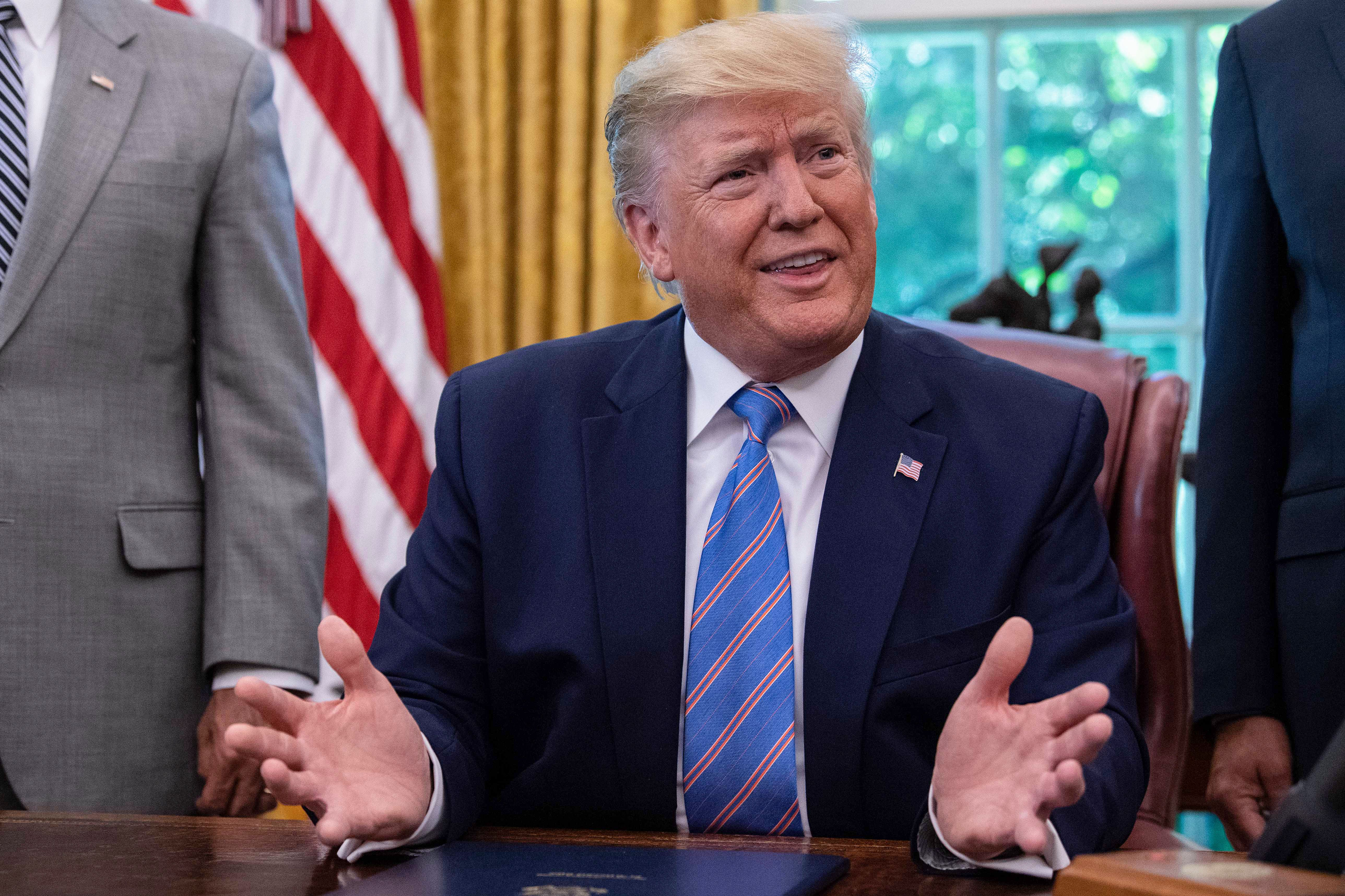 President Donald Trump speaks to the press after signing a bill for border funding legislation on July 1, 2019. (Nicholas Kamm/AFP/Getty Images)