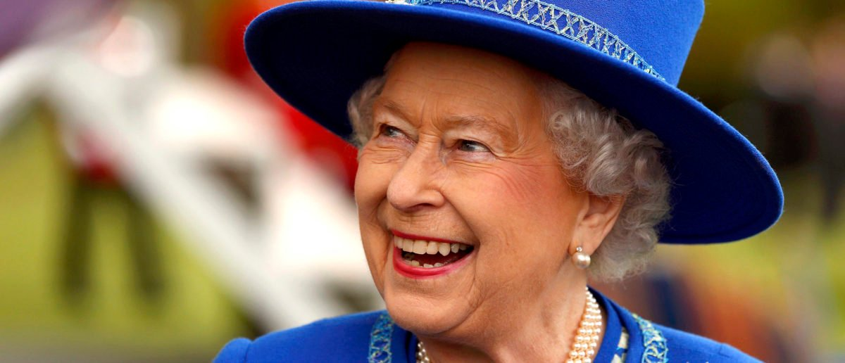 Queen Elizabeth II reacts after presenting New Colours to the 1st Battalion Welsh Guards at Windsor Castle on April 30, 2015 in London, United Kingdom. (Cathal McNaughton - Pool /Getty Images)