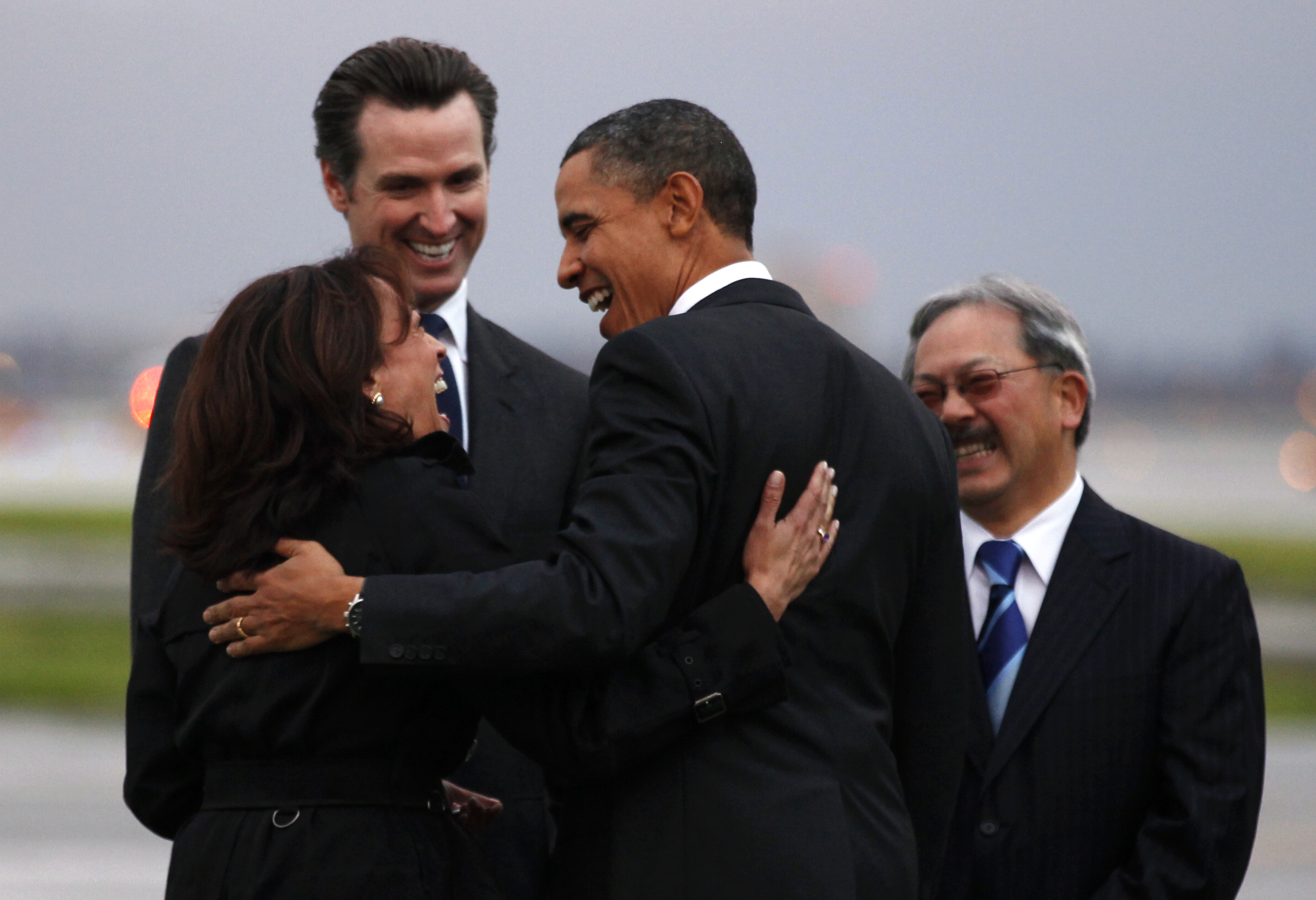 U.S. President Barack Obama is greeted by California Attorney General Kamala Harris (L), California Lieutenant Governor Gavin Newsom (2nd L) and San Francisco Mayor Edwin Lee (R) upon his arrival in San Francisco February 17, 2011. Kevin Lamarque/Reuters