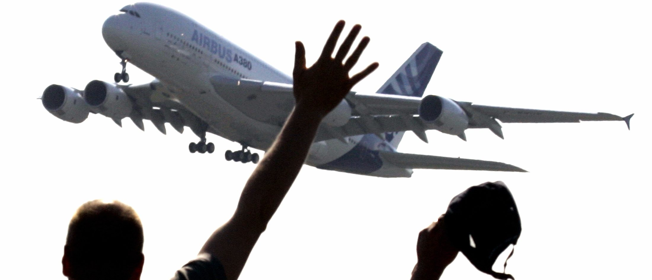 Spectators wave as they watch the world's biggest airliner, the Airbus A380, taking off on its maiden flight in southwestern France. REUTERS/Eric Gaillard