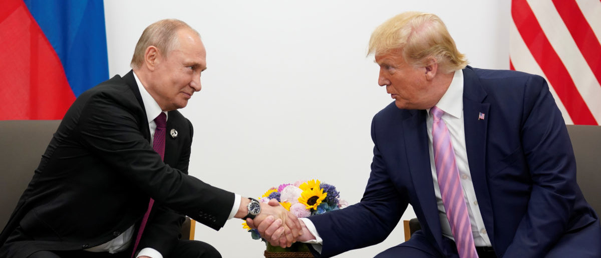 Russia's President Vladimir Putin and U.S. President Donald Trump shake hands during a bilateral meeting at the G20 leaders summit in Osaka, Japan, June 28, 2019. REUTERS/Kevin Lamarque