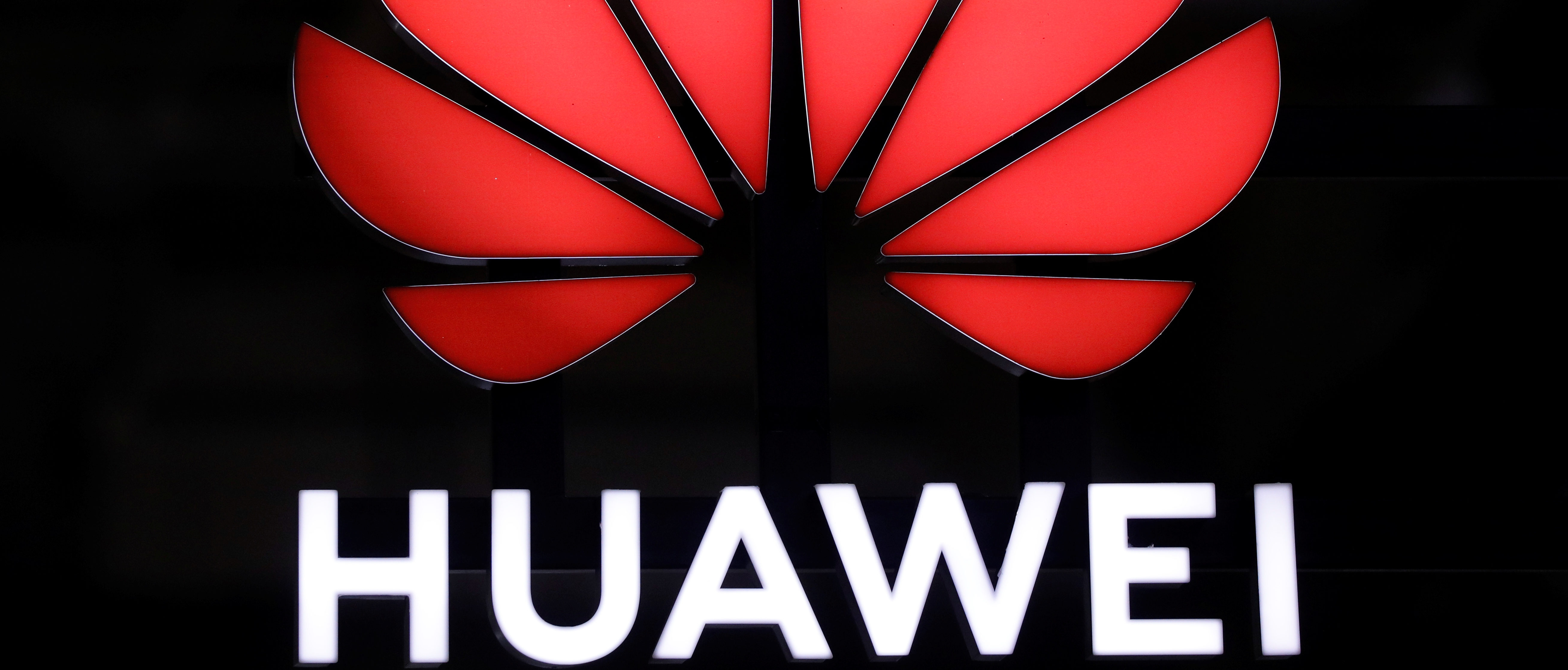 A Huawei signage is pictured at their booth at Interpol World in Singapore July 2, 2019. REUTERS/Edgar Su - RC1DE20F0440