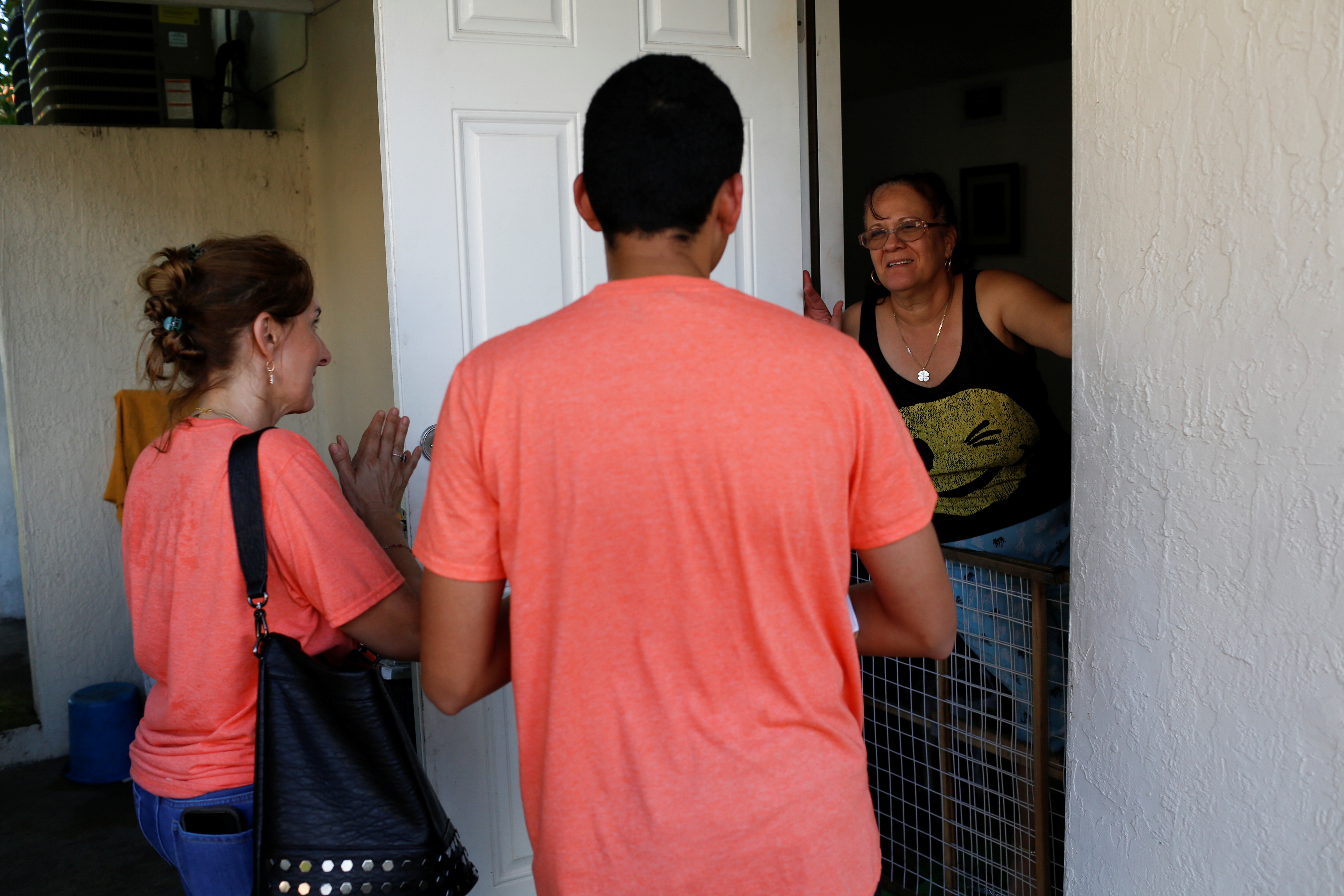 Immigration rights activists hand out pamphlets as communities braced for a reported wave of deportation arrests across the United States by Immigration and Customs Enforcement officers (REUTERS/Marco Bello)