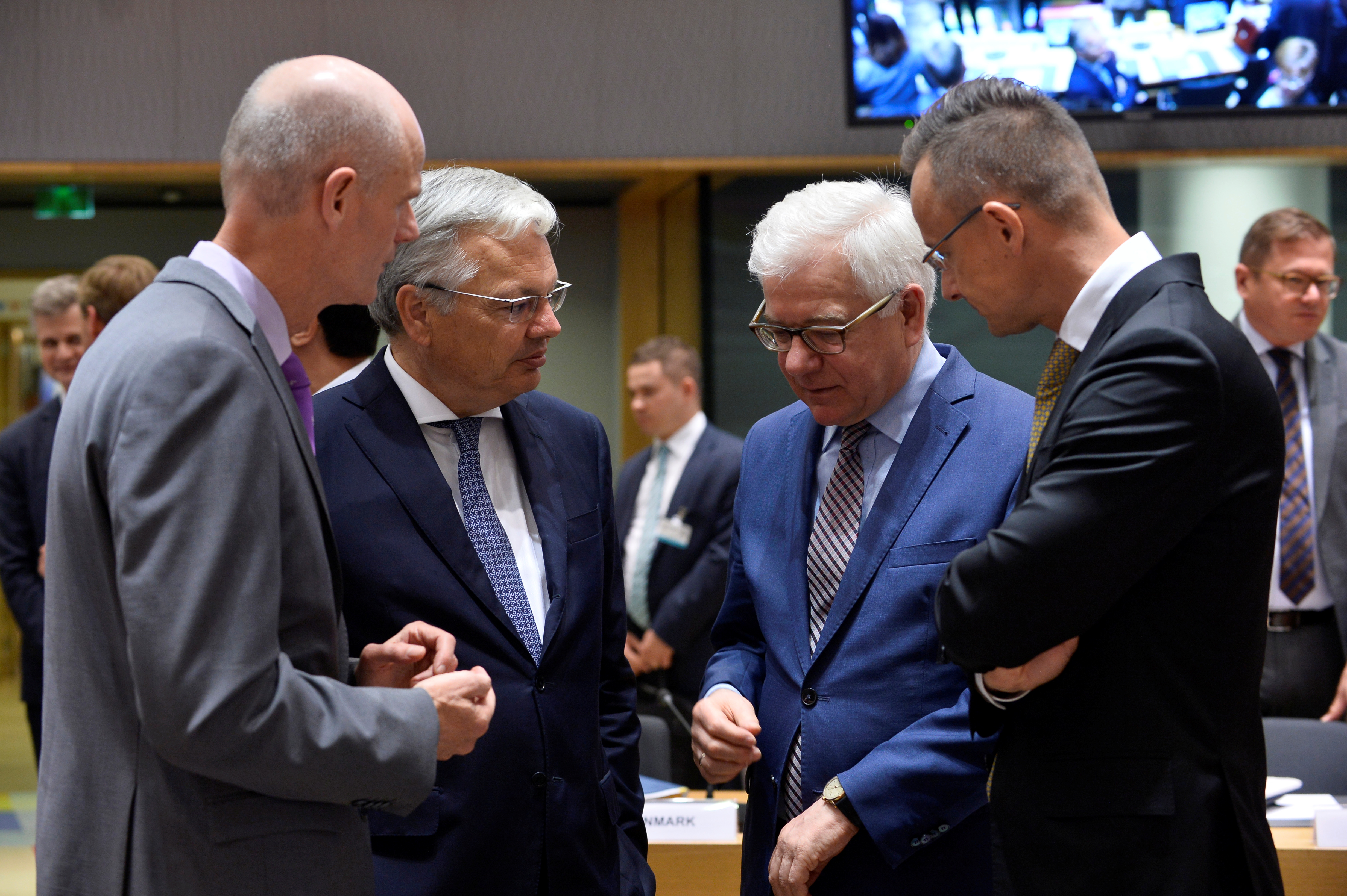 Foreign Ministers of the Netherlands, Stef Blok, Belgium, Didier Reynders, Poland, Jacek Czaputowicz and Hungary, Peter Szijjarto, attend a EU foreign ministers meeting in Brussels, Belgium July 15, 2019. REUTERS/Johanna Geron - RC1AAC9A8A90