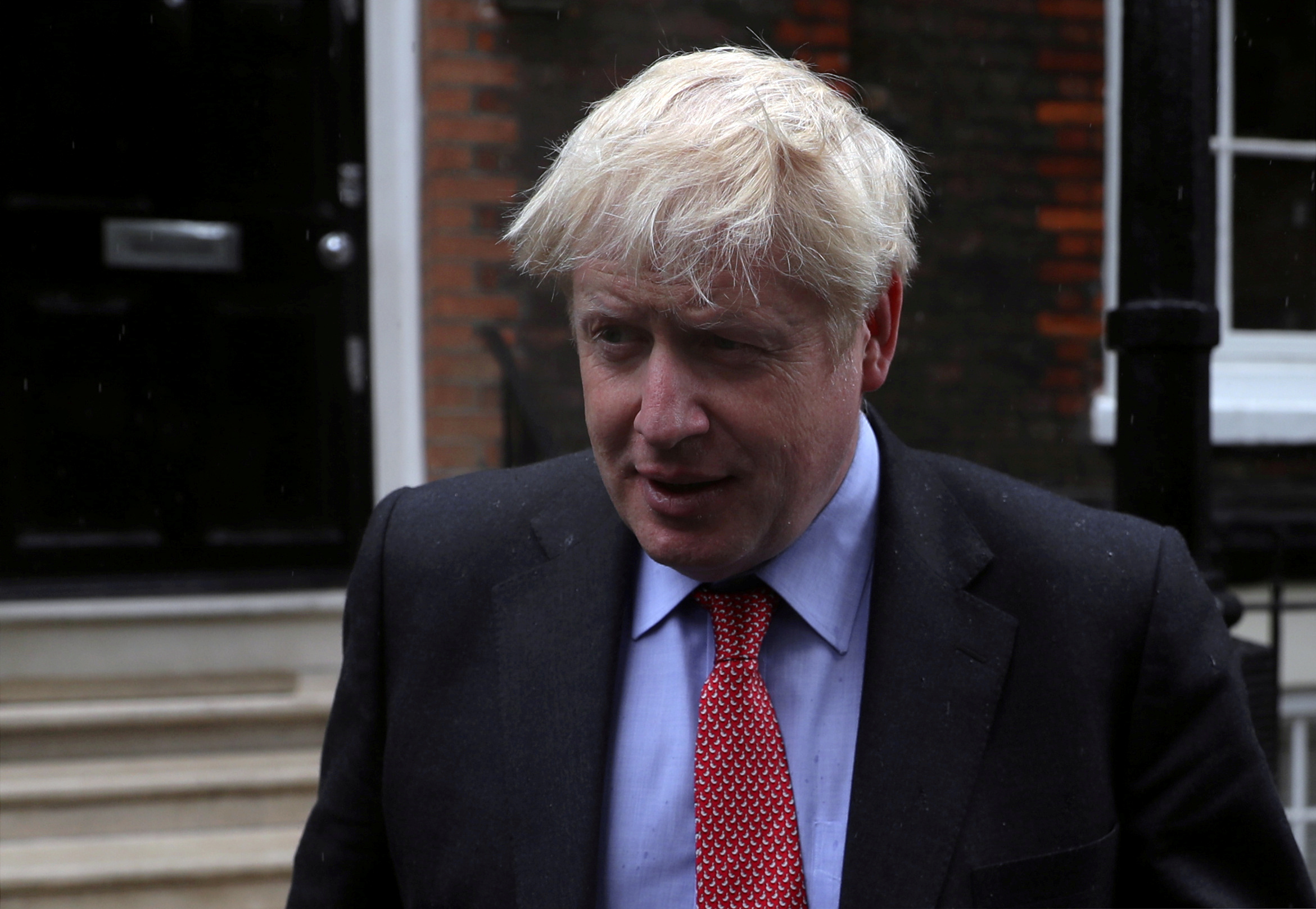 FILE PHOTO: Boris Johnson, a leadership candidate for Britain's Conservative Party, leaves offices in central in London, Britain, July 19, 2019. REUTERS/Simon Dawson/File Photo