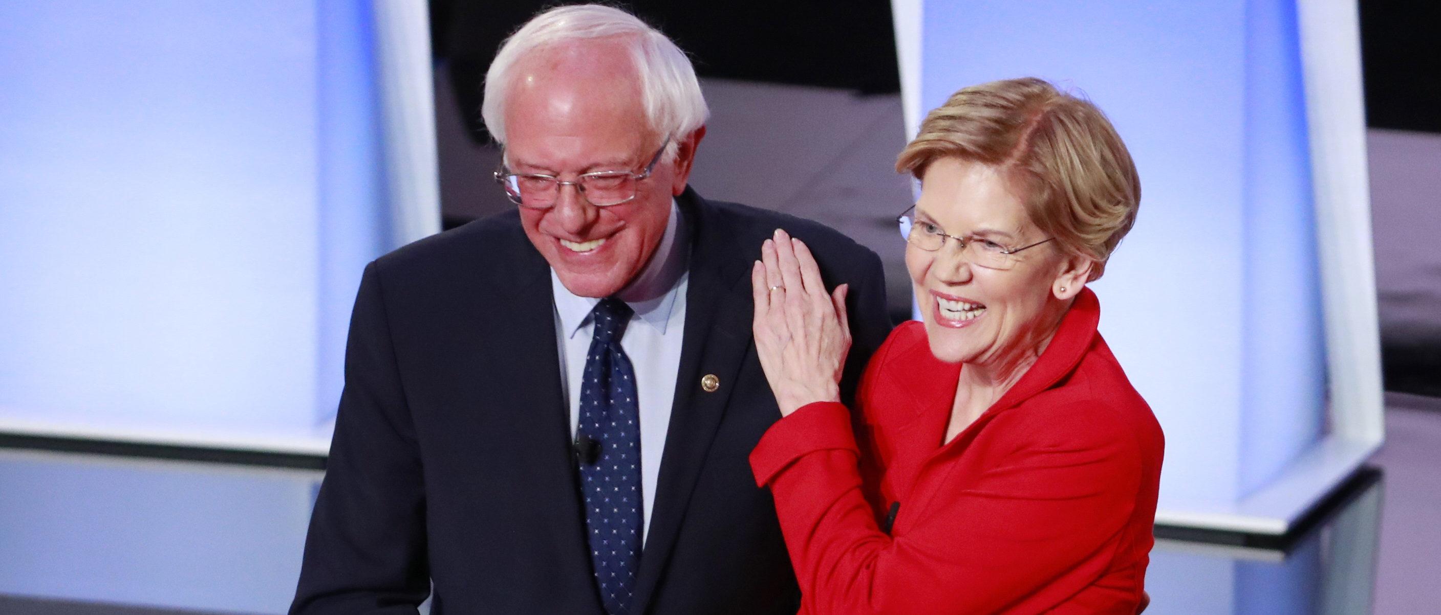 U.S. Senator Bernie Sanders and U.S. Senator Elizabeth Warren shake hands before the start of the first night of the second 2020 Democratic U.S. presidential debate in Detroit, Michigan, U.S., July 30, 2019. REUTERS/Lucas Jackson - HP1EF7V00K8IB