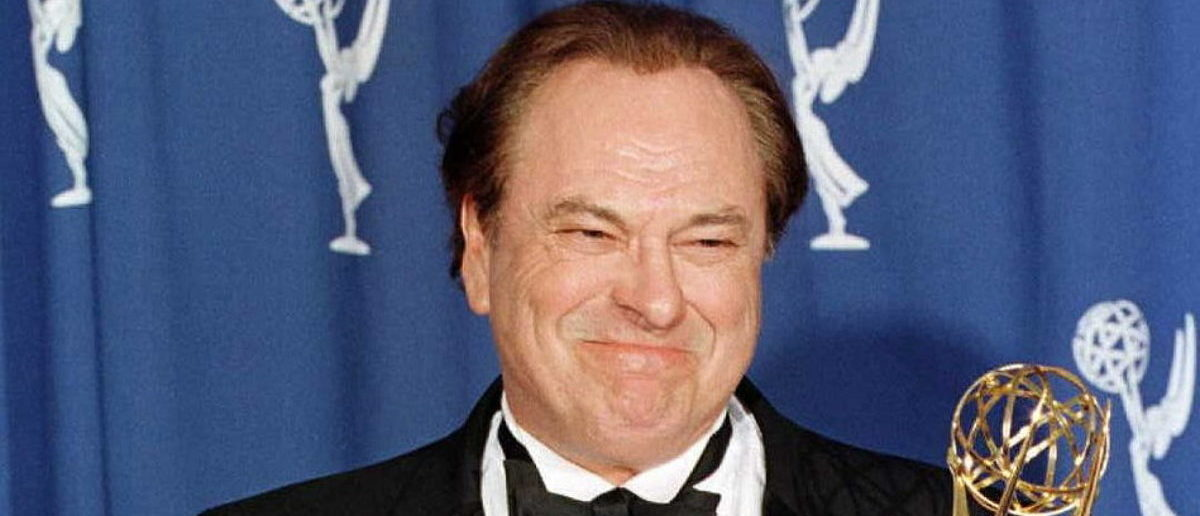 """PASADENA, : Actor Rip Torn gives the thumbs up as he holds his Emmy Award for Outstanding Supporting Actor in a Comedy Series for his role as Arthur on the """"The Larry Sanders Show"""" at the 48th Annual Primetime Emmy Awards 08 September in Pasadena, California. (Photo credit: KIM KULISH/AFP/Getty Images)"""
