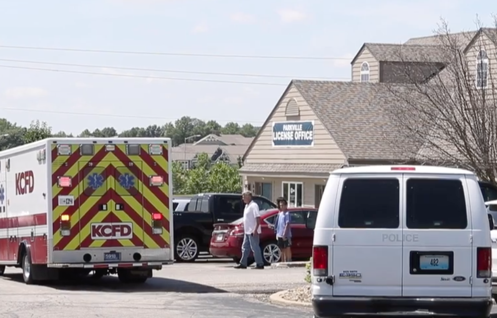 A woman was transported away from the scene in a police van after firing her gun in the parking lot of a Kansas City DMV, police reported. July 9, 2019. Photo Youtube screenshot courtesy of the Kansas City Star.