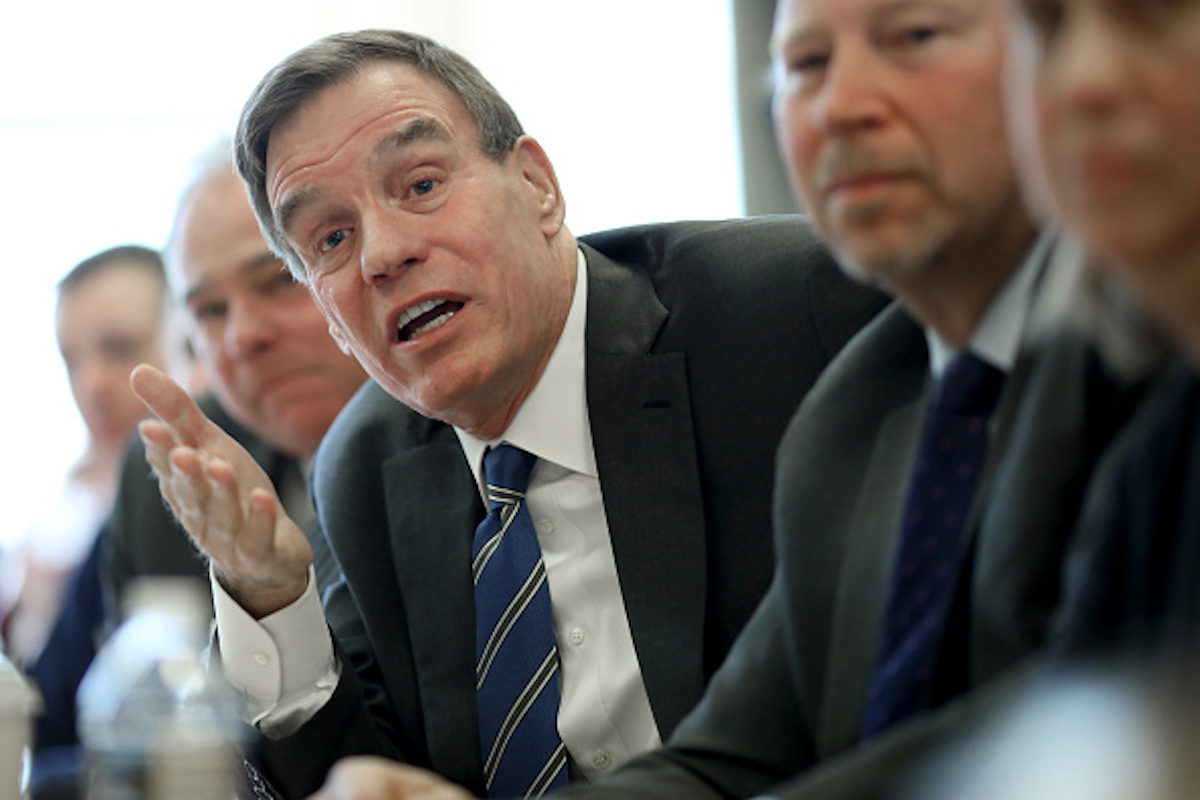 ALEXANDRIA, VA - JANUARY 11: Sen. Mark Warner (C) (D-VA) and Sen. Tim Kaine (2nd L) (D-VA) talk with furloughed government employees about how the government shutdown has impacted their lives and finances during a roundtable discussion in Alexandria, Virginia January 11, 2019. Government employees will miss their first paycheck today as the shutdown threatens to become the longest shutdown in history. (Photo by Win McNamee/Getty Images)