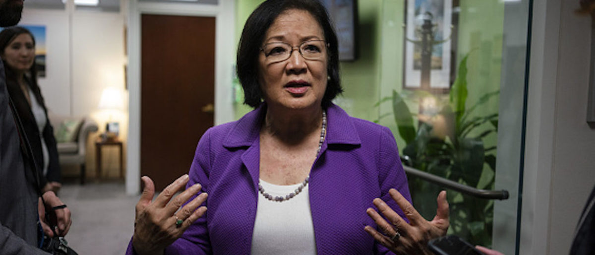 Senator Mazie Hirono, a Democrat from Hawaii, speaks with reporters on Capitol Hill in Washington, D.C., U.S., on Thursday, Sept. 20, 2018. Senate Judiciary Chairman?Chuck Grassley?is sticking with his plan to hold the Supreme Court nominee?Brett Kavanaugh hearing on Monday and has refused to expand the witness list beyond Kavanaugh and accuser Christine Blasey Ford, or to ask for an FBI investigation of the woman's claims of sexual assault. Photographer: Aaron P. Bernstein/Bloomberg via Getty Images