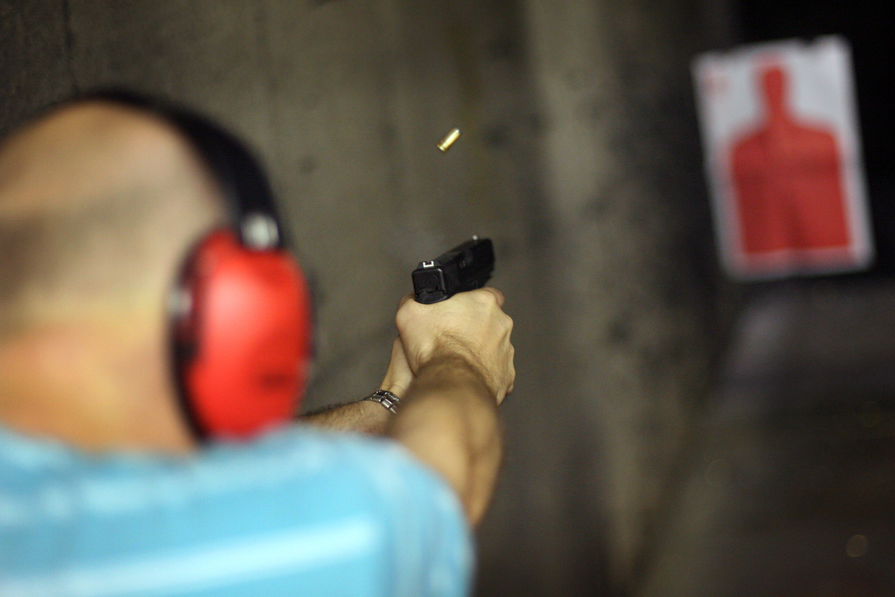 A marksman shoots his Glock pistol at the DFW Gun Range and Training Center in Dallas, Texas (Rick Gershon/Getty Images)