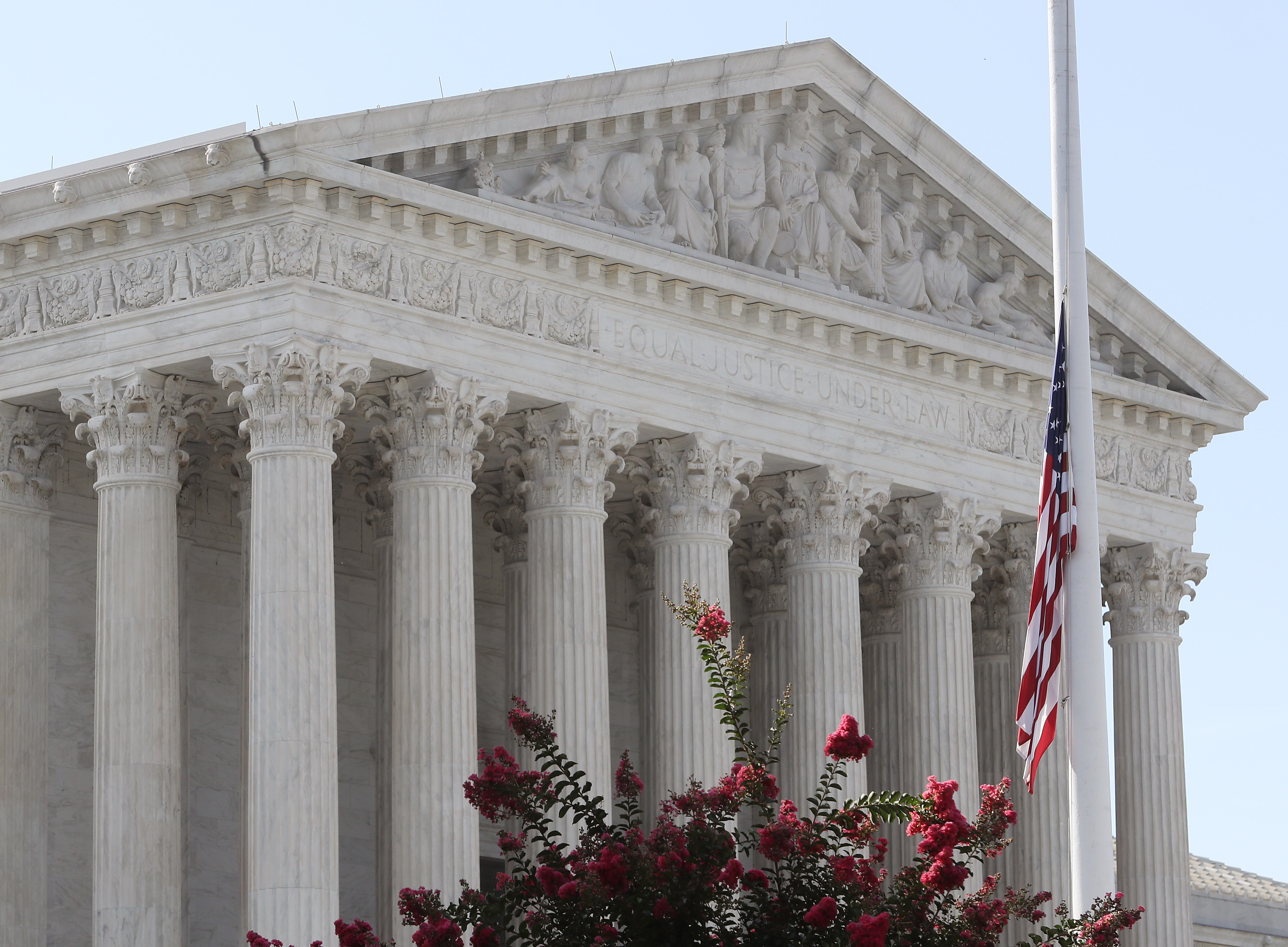 Flags are at half-staff in front of the Supreme Court to honor retired Justice John Paul Stevens who died on July 17, 2019. (Mark Wilson/Getty Images)