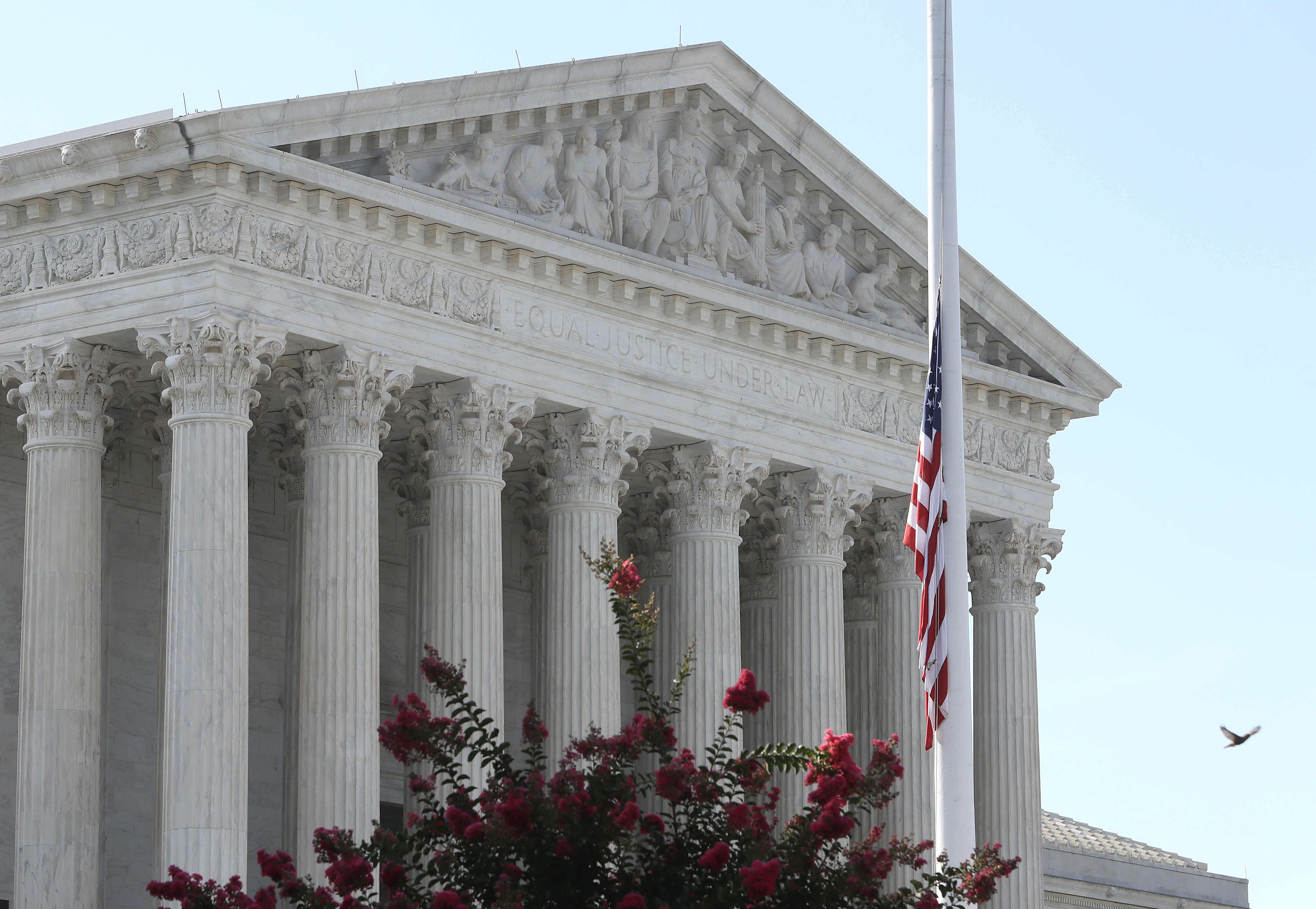 Flags fly at half-staff in front of the Supreme Court to honor Justice John Paul Stevens, who died on July 17, 2019. (Mark Wilson/Getty Images)