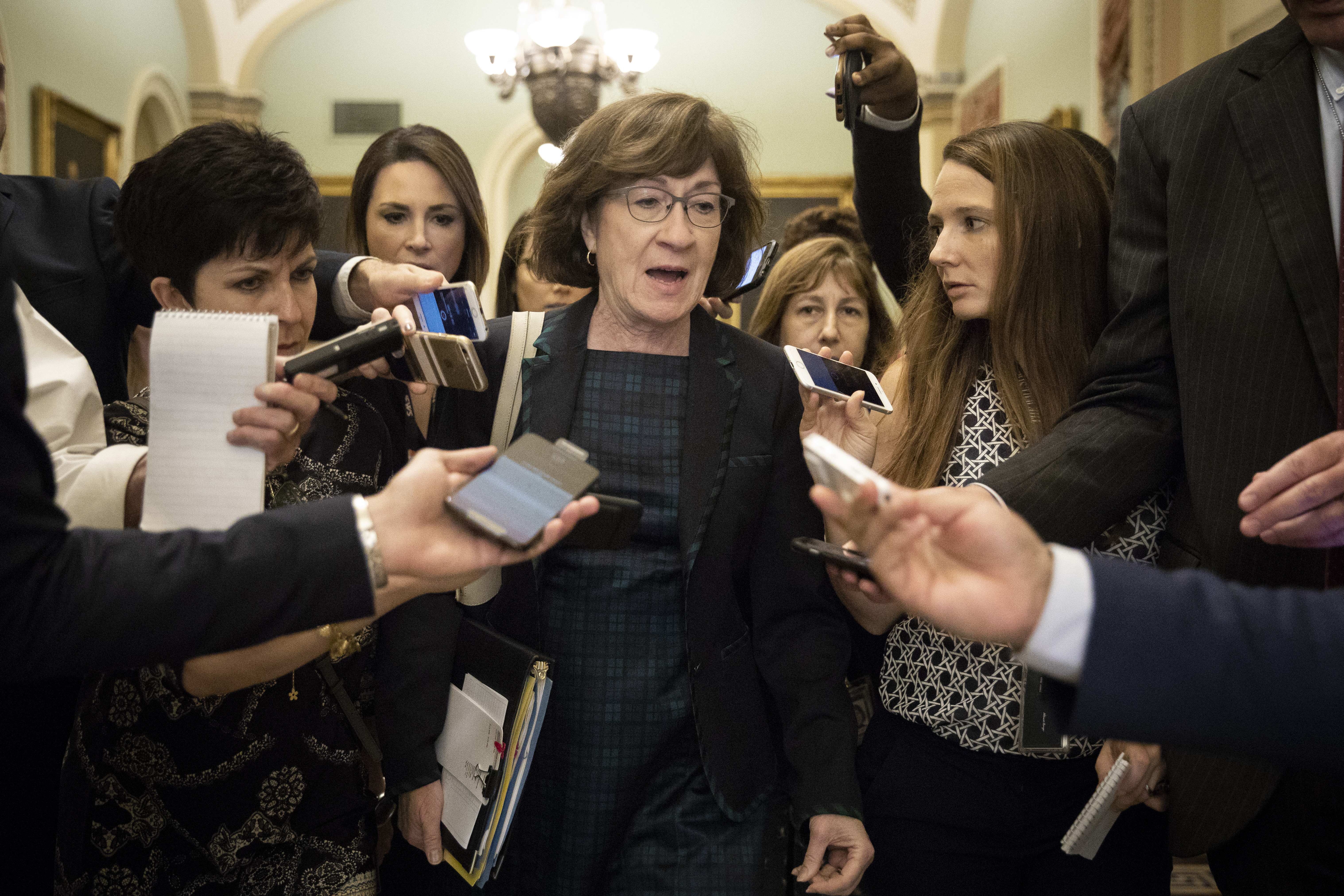 Sen. Susan Collins (R-ME) is surrounded by reporters on September 26, 2018 ahead of Christine Blasey Ford's testimony before the Senate Judiciary Committee. (Drew Angerer/Getty Images)