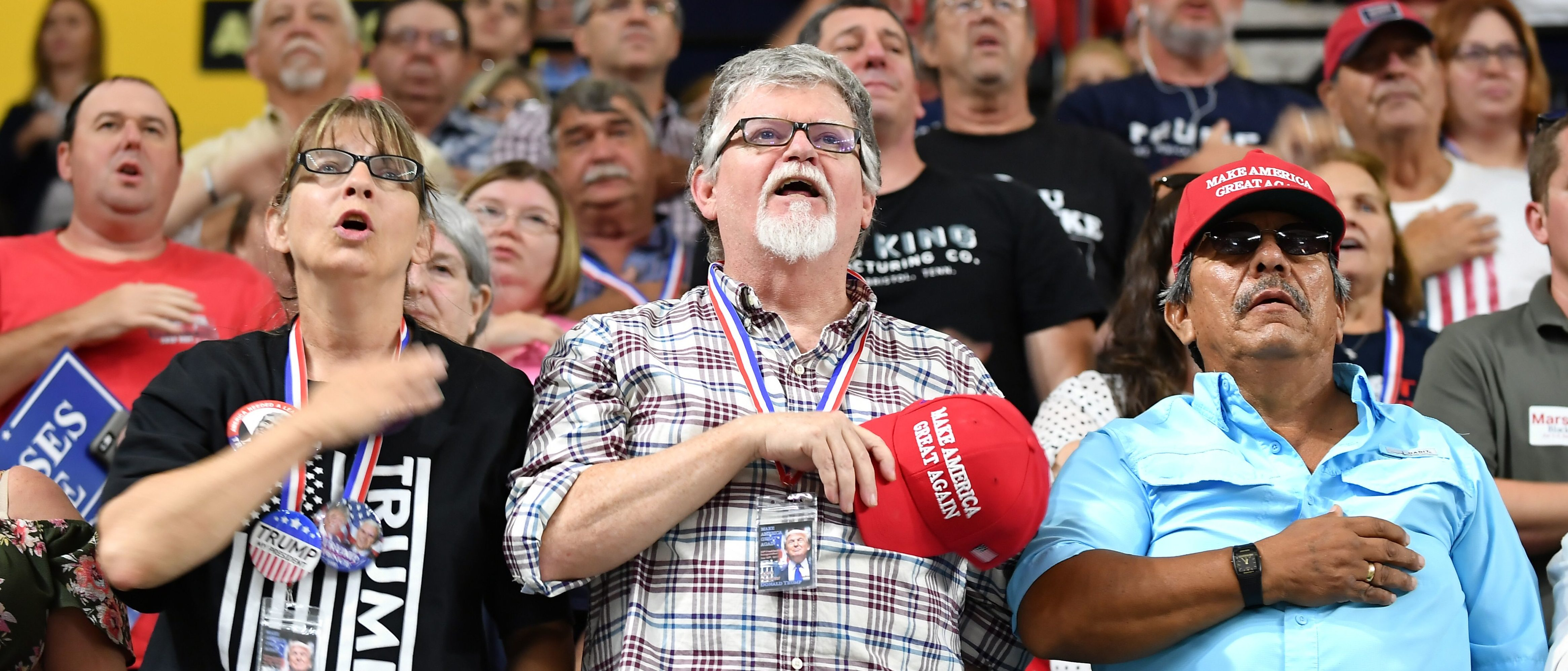 "Supporters recite the Pledge of Allegiance prior to US President Donald Trump speaking at a ""Make America Great Again"" rally at Freedom Hall Civic Center in Johnson City, Tennessee on October 1, 2018. (Photo by MANDEL NGAN/AFP/Getty Images)"