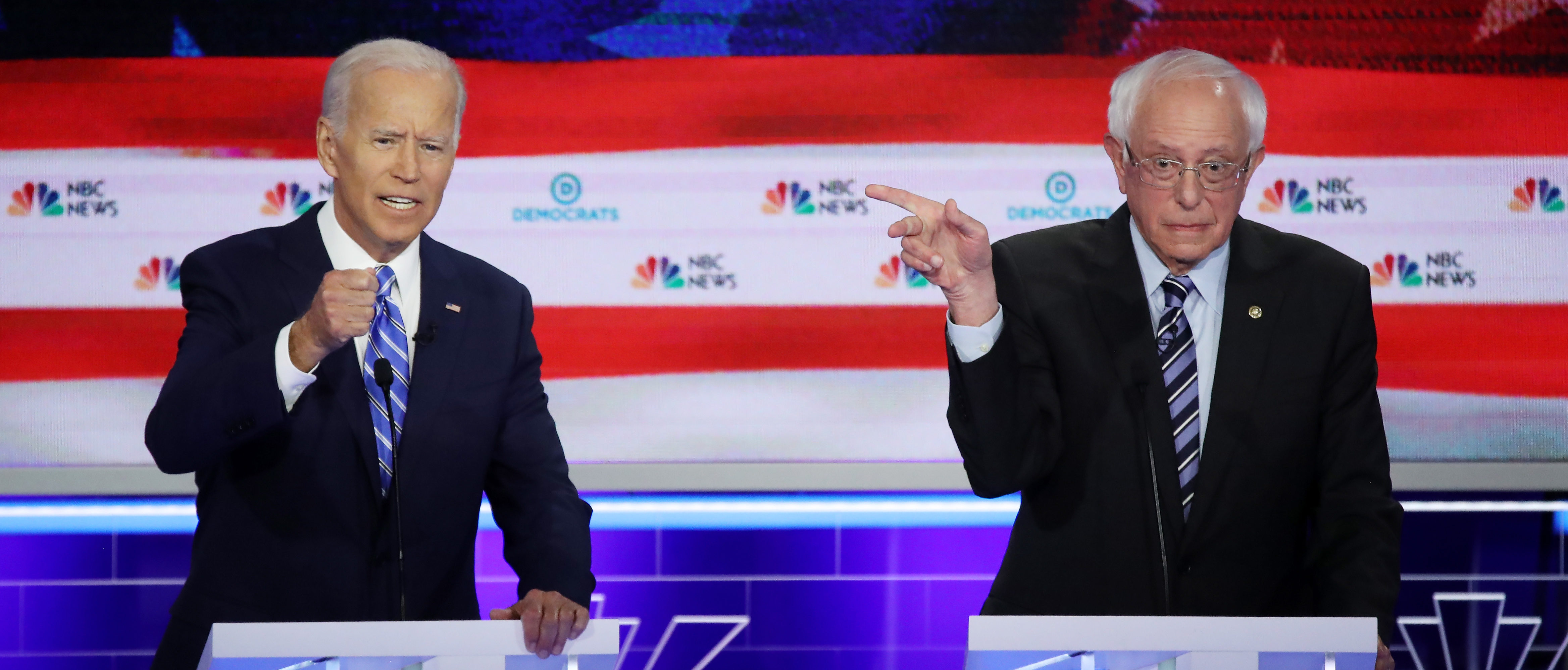 Democratic presidential candidates former Vice President Joe Biden and Sen. Bernie Sanders speak during the second night of the first Democratic presidential debate on June 27, 2019 in Miami, Florida. (Drew Angerer/Getty Images)