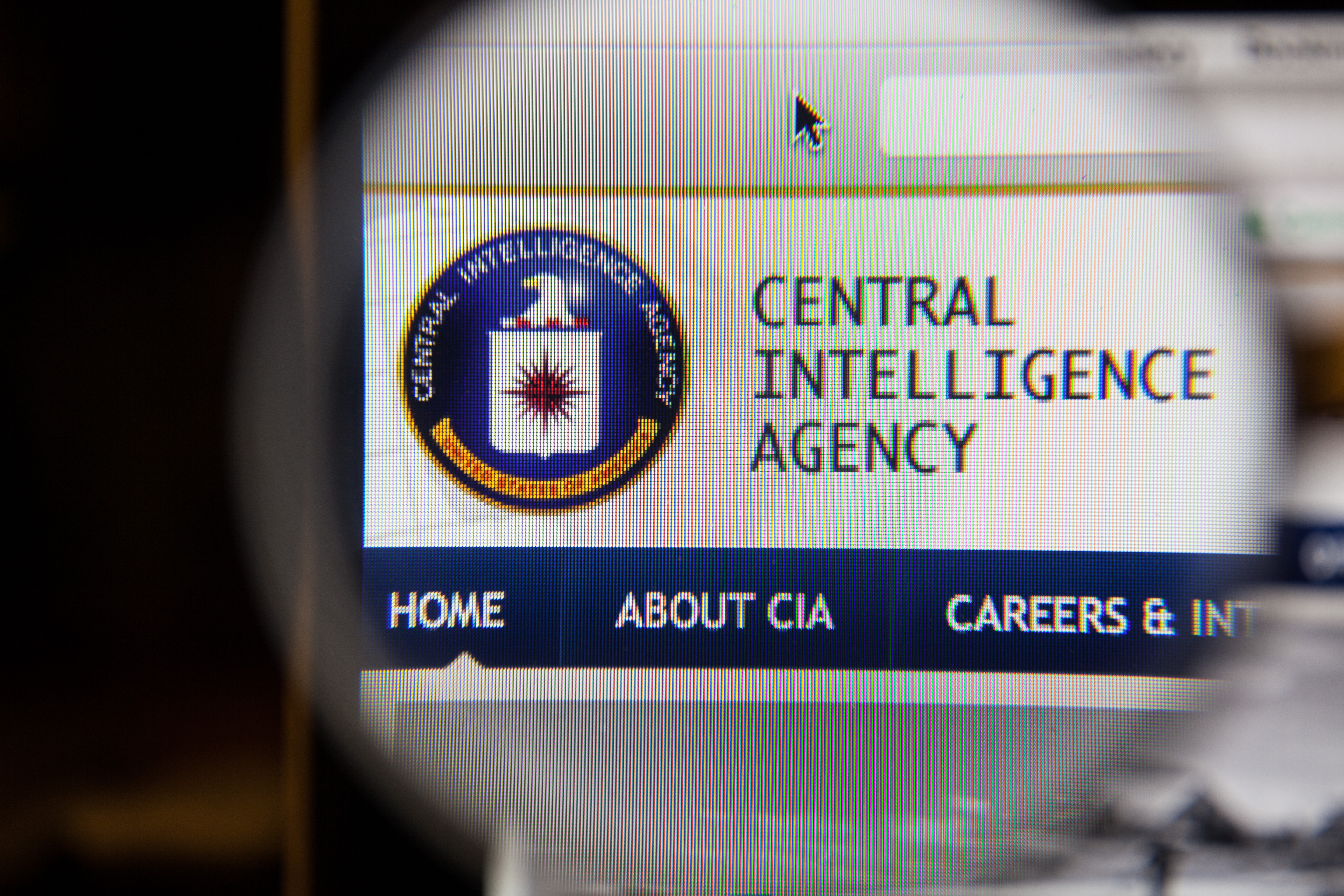 A screen displays the CIA logo. Shutterstock image via aradaphotography