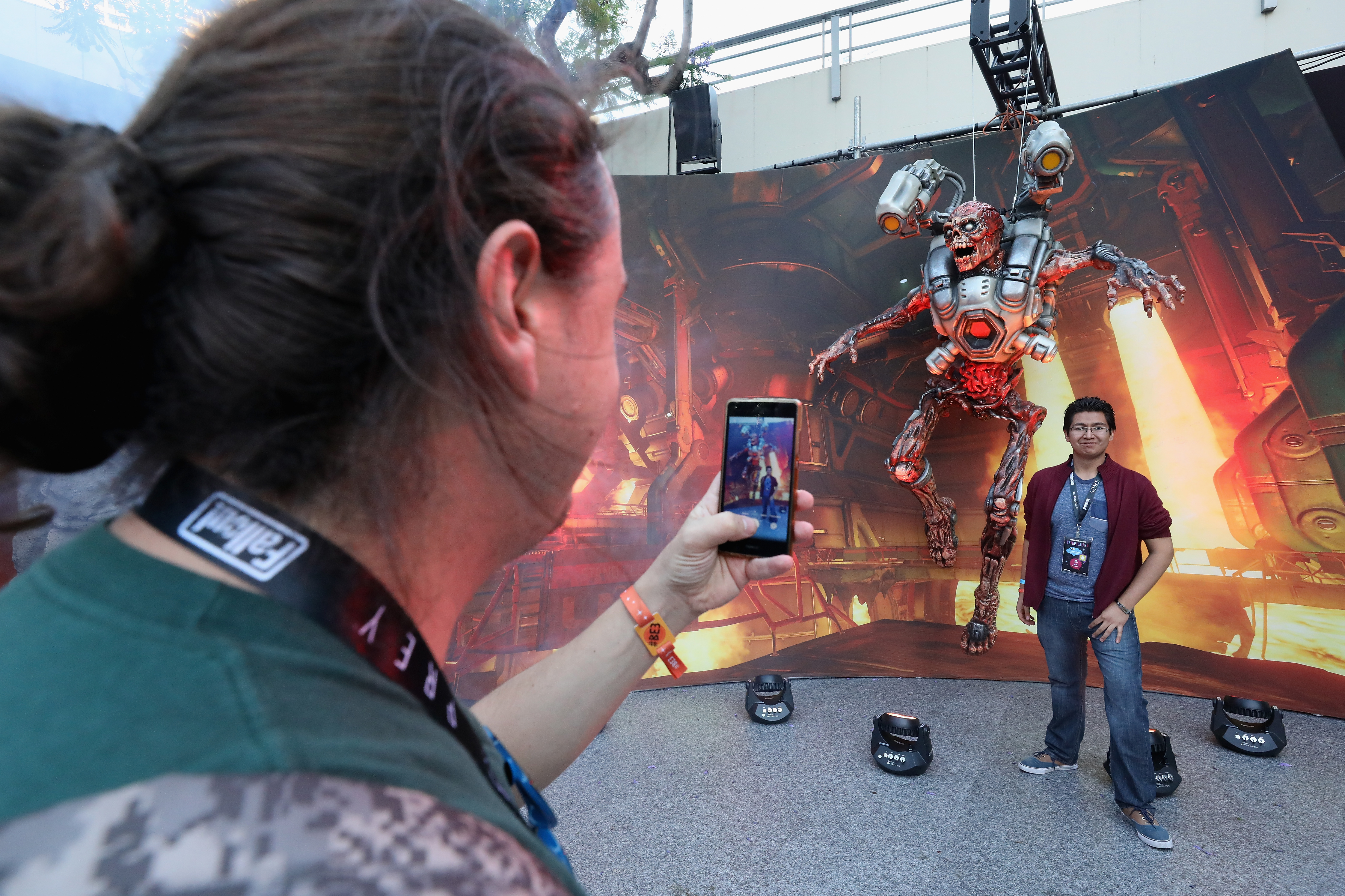 LOS ANGELES, CA - JUNE 11: David Sanchez of Mexico City, Mexico poses for a photograph under a 'Doom' statue at the Bethesda E3 conference at the LA Center Studios on June 11, 2017 in Los Angeles, California. The E3 Game Conference begins on Tuesday June 13. (Photo by Christian Petersen/Getty Images)