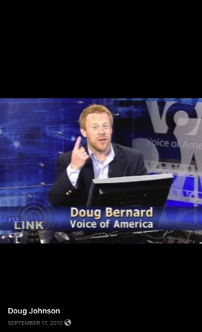 "The ""Doug Johnson"" Facebook page includes a photo where Doug Bernard can be seen and identified by chyron in front of a VOA sign. (Facebook Screenshot/Doug Johnson)"