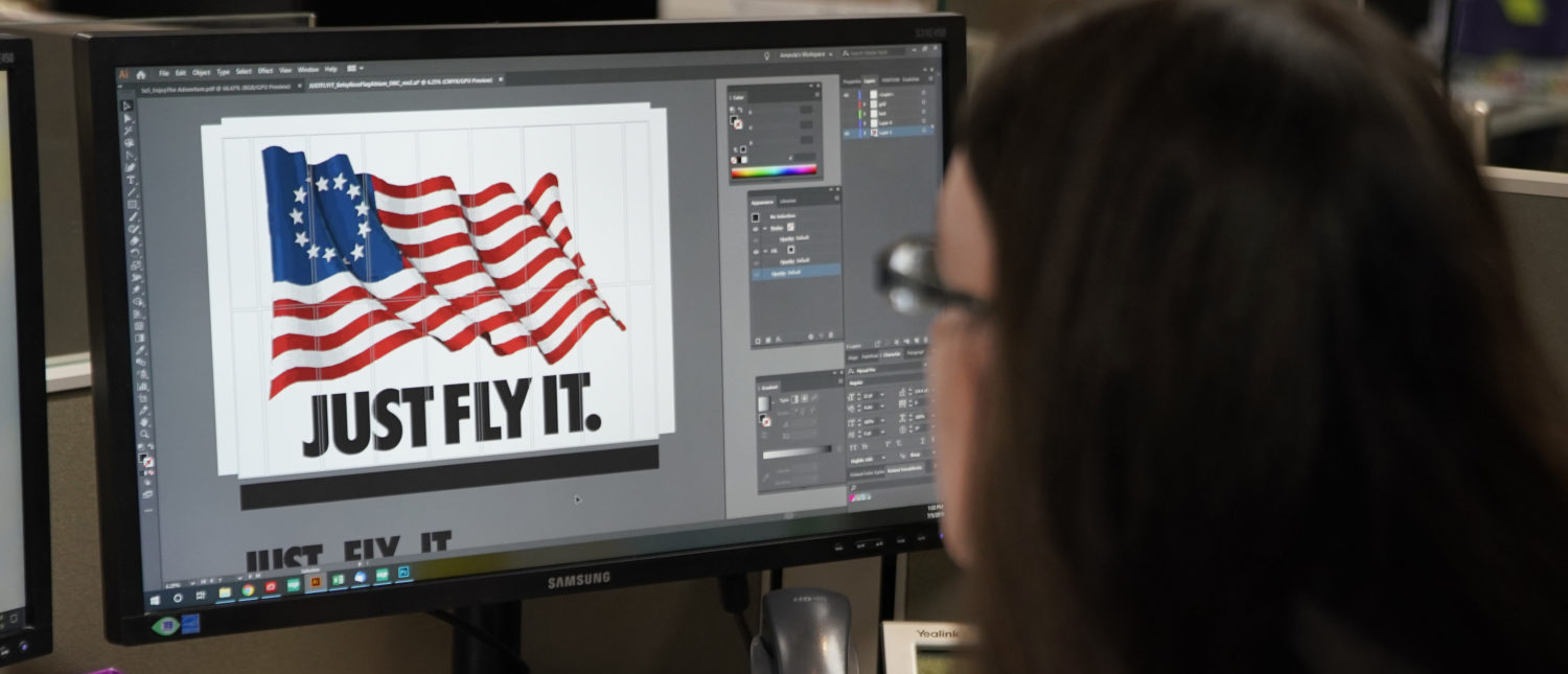 SALT LAKE CITY, UT - JULY 05: A worker designs a Just Fly It t-shirt with the Betsy Ross flag at Colonial Flag on July 5, 2019 in Salt Lake City, Utah. The Betsy Ross Flag became a controversy last week when Nike removed shoes with the flag on it from stores after Colin Kaepernick express concern for what the flag represented. (Photo by George Frey/Getty Images)