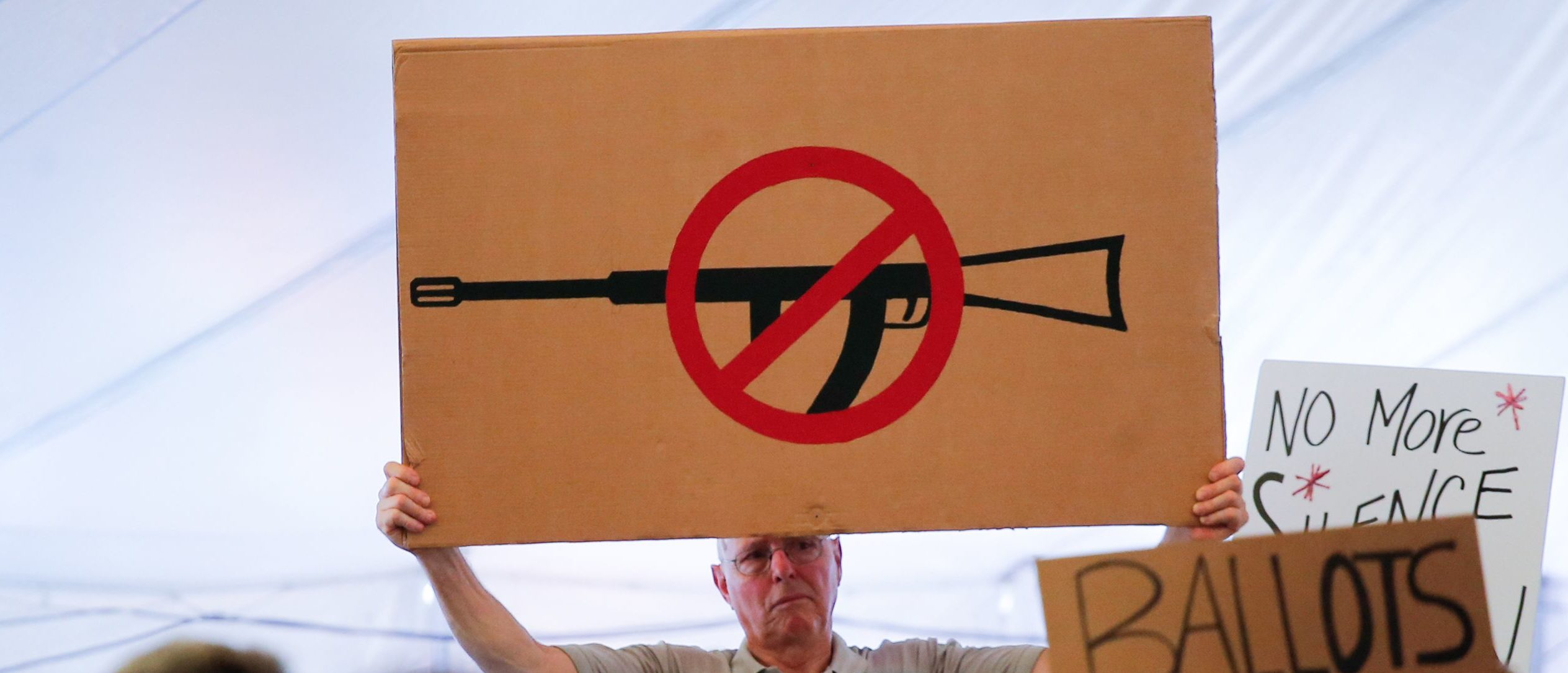 A man displays an anti gun violence sign during a March for our Lives Rally at Fairfield Hills Campus, in Newtown Connecticut on August 12, 2018. (Photo by KENA BETANCUR/AFP/Getty Images)