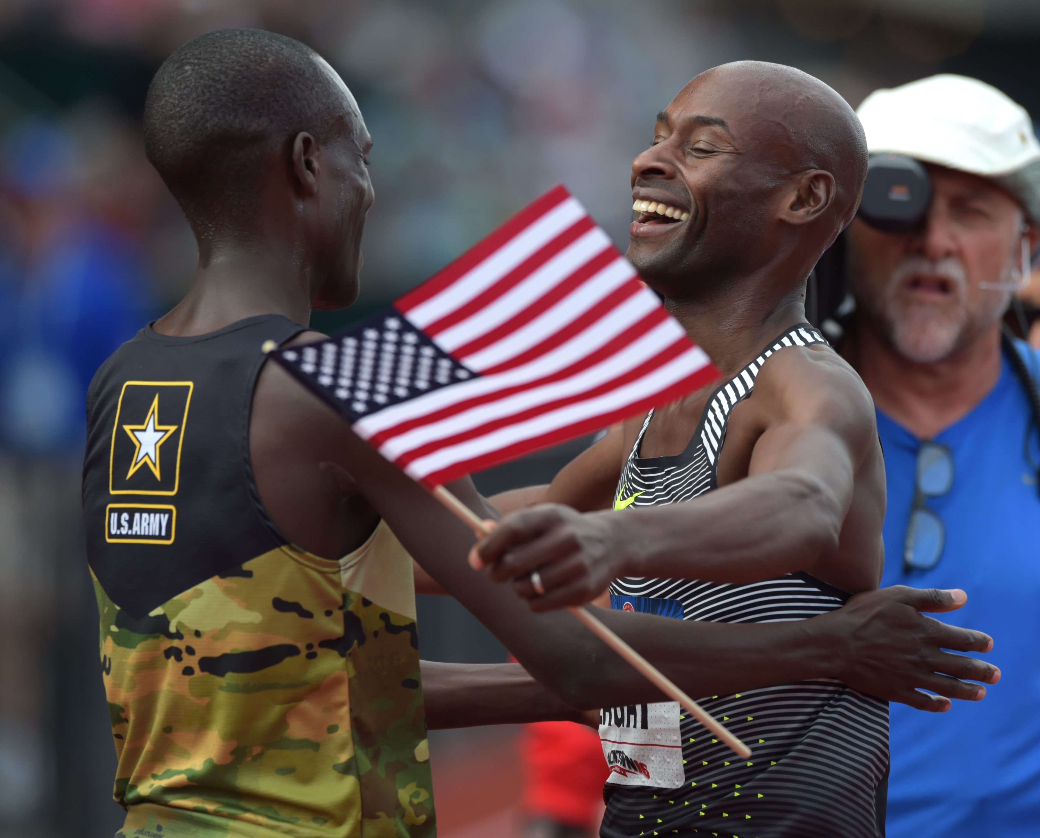 Jul 9, 2016; Eugene, OR, USA; Bernard Lagat (right) reacts with Shadrack Kipchirchir (left) after winning the men's 5000m final during the 2016 U.S. Olympic track and field team trials at Hayward Field. Mandatory Credit: Glenn Andrews-USA TODAY Sports