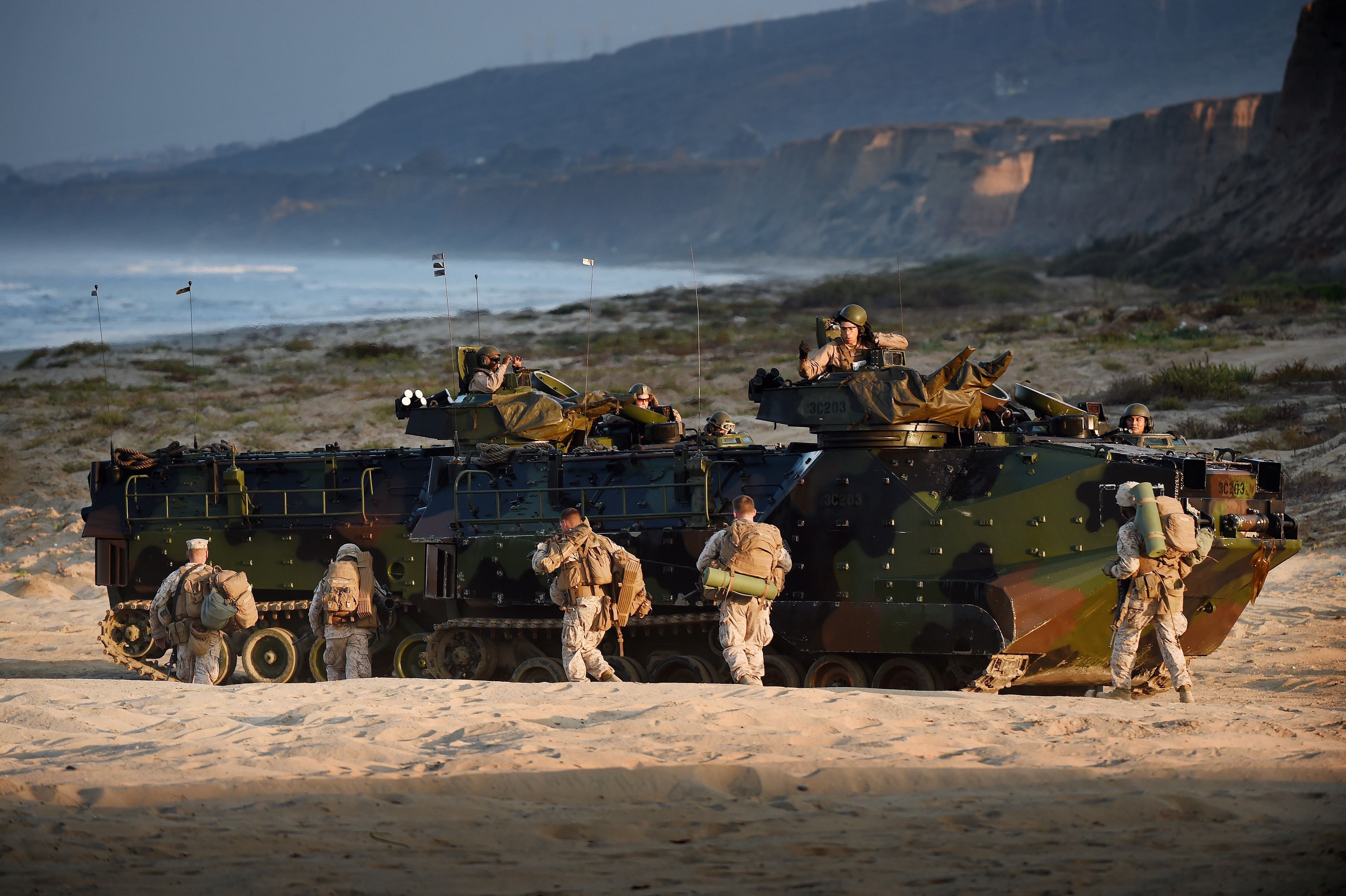 US Marines take their positions during an amphibious landing operation at the Dawn Blitz 2015 exercise in Camp Pendleton, California on September 5, 2015. (Photo by MARK RALSTON/AFP/Getty Images)