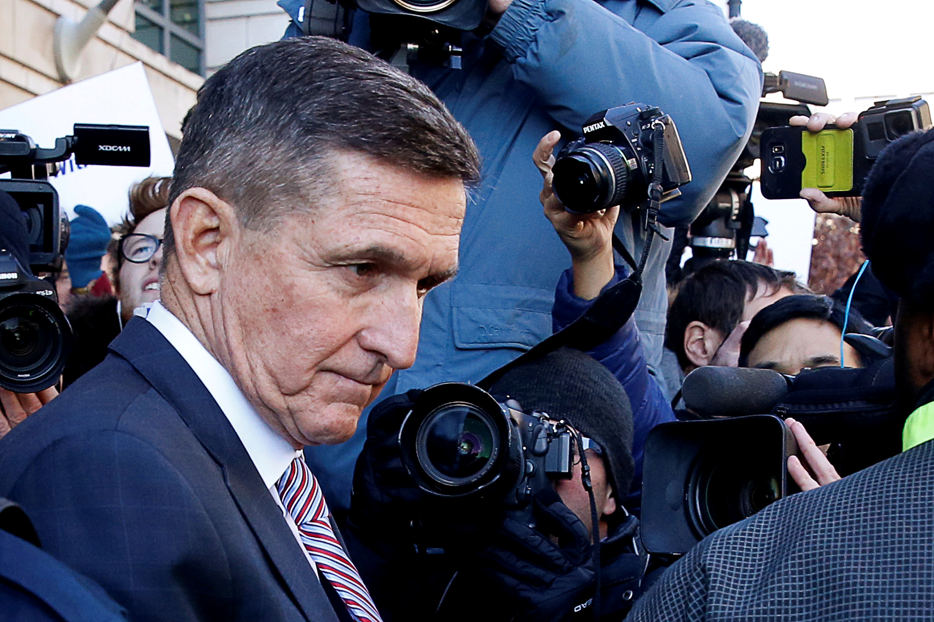 Former U.S. national security adviser Michael Flynn passes by members of the media as he departs after his sentencing was delayed at U.S. District Court in Washington, U.S., December 18, 2018. REUTERS/Joshua Roberts